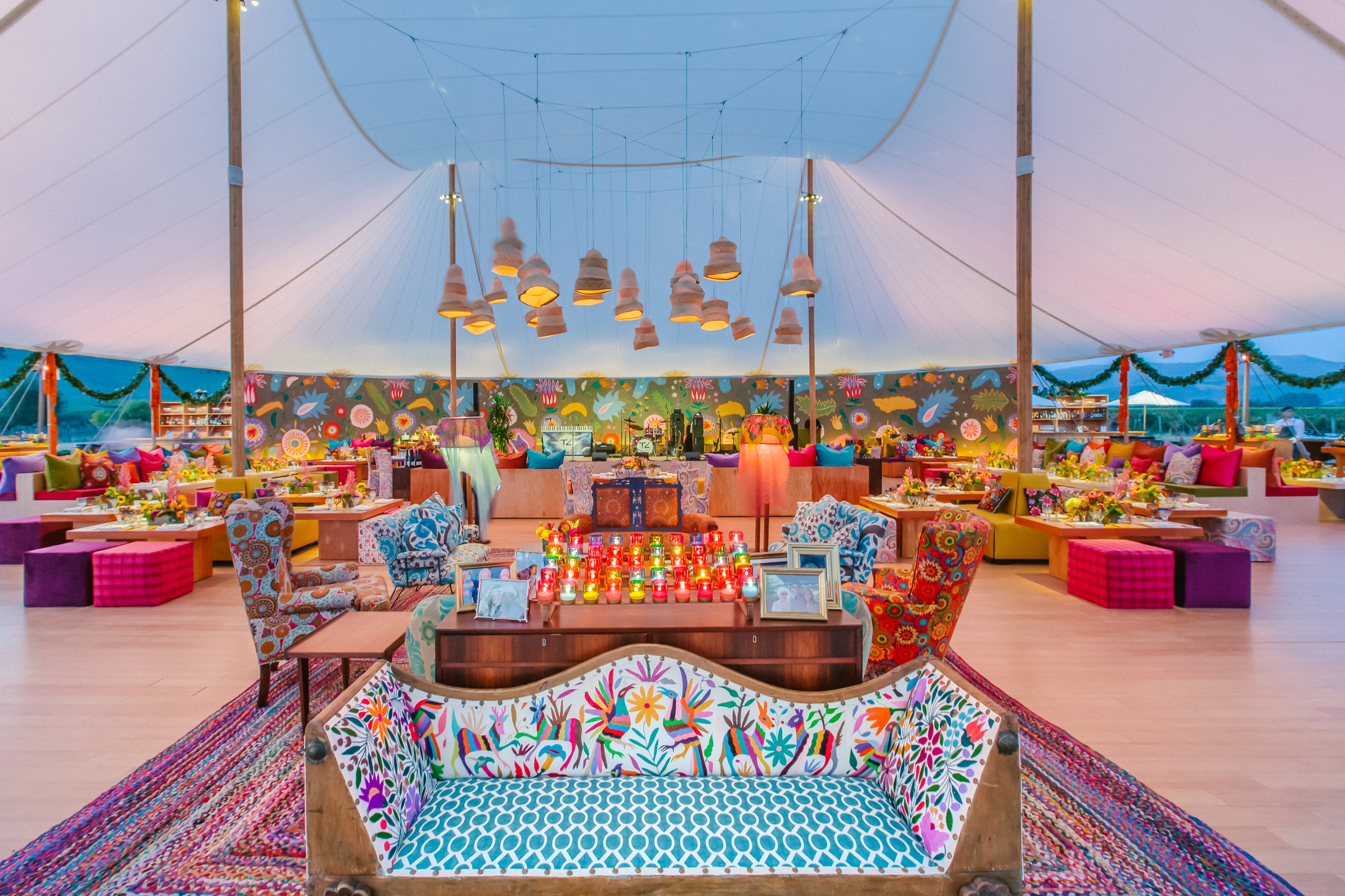 Tented reception decor in festive colors - photo by Amy and Stuart Photography