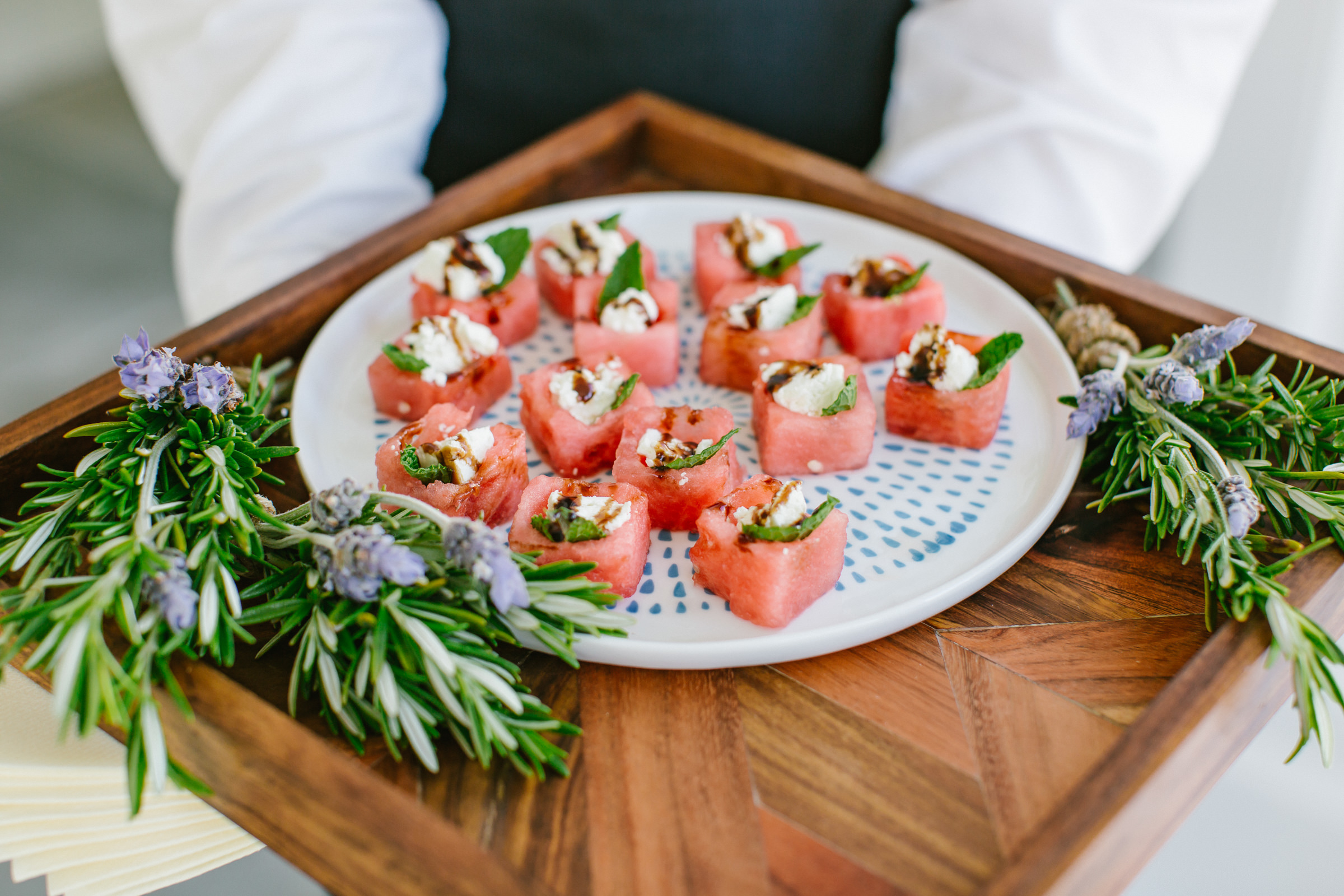 Tuna hors d'oeuvres offered on tray with rosemary garnish - photo by Amy and Stuart Photography