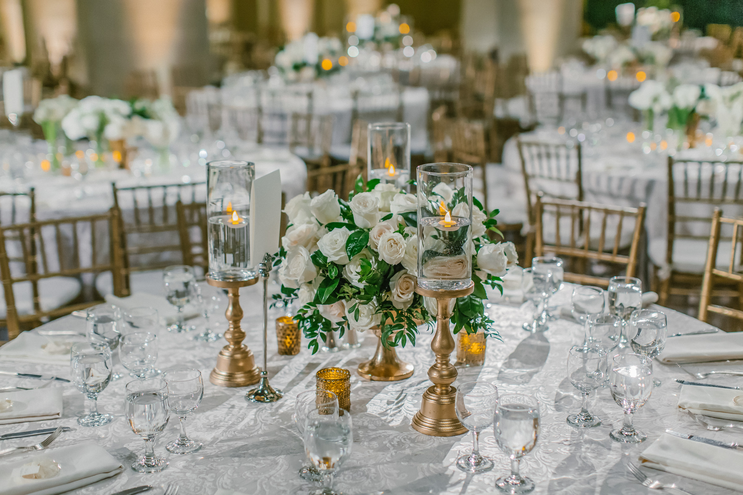 white rose floral centerpieces with gold accent reception decor- photo by Amy and Stuart Photography