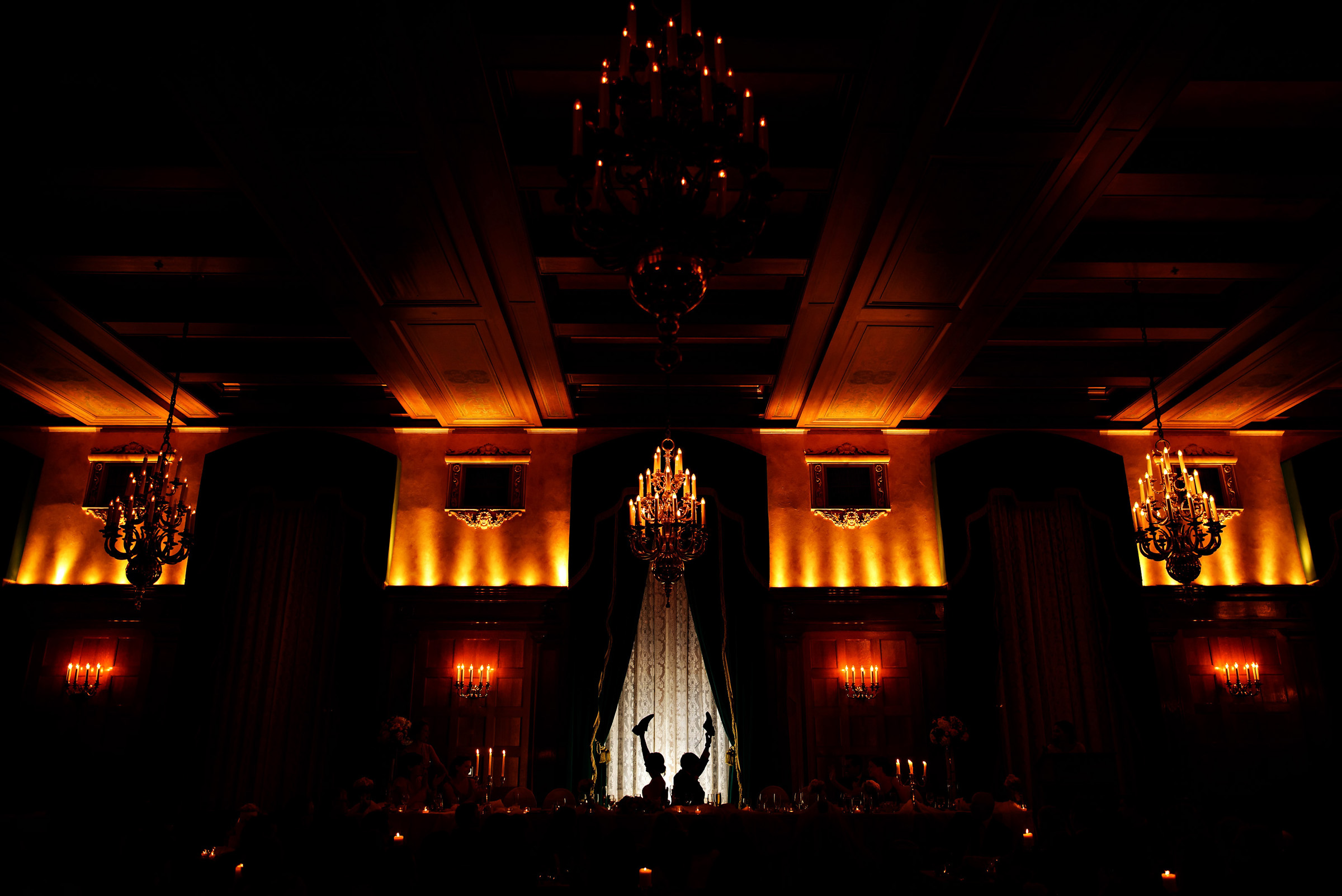 Couple silhouette in reception hall - photo by Moore Photography