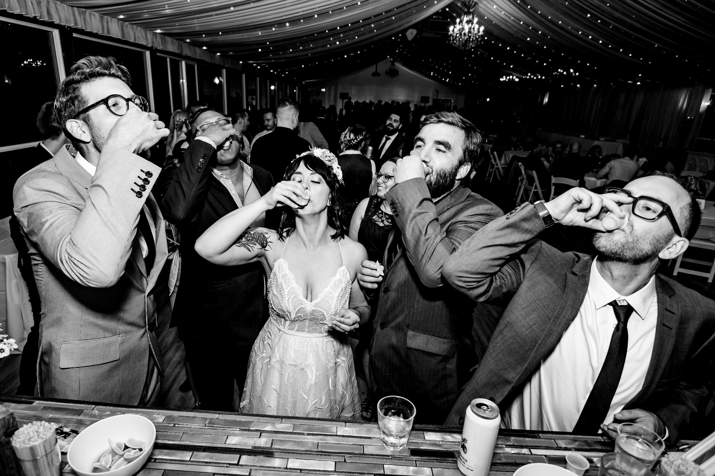 Bride and guests having tequila shots at the bar- photo by Moore Photography