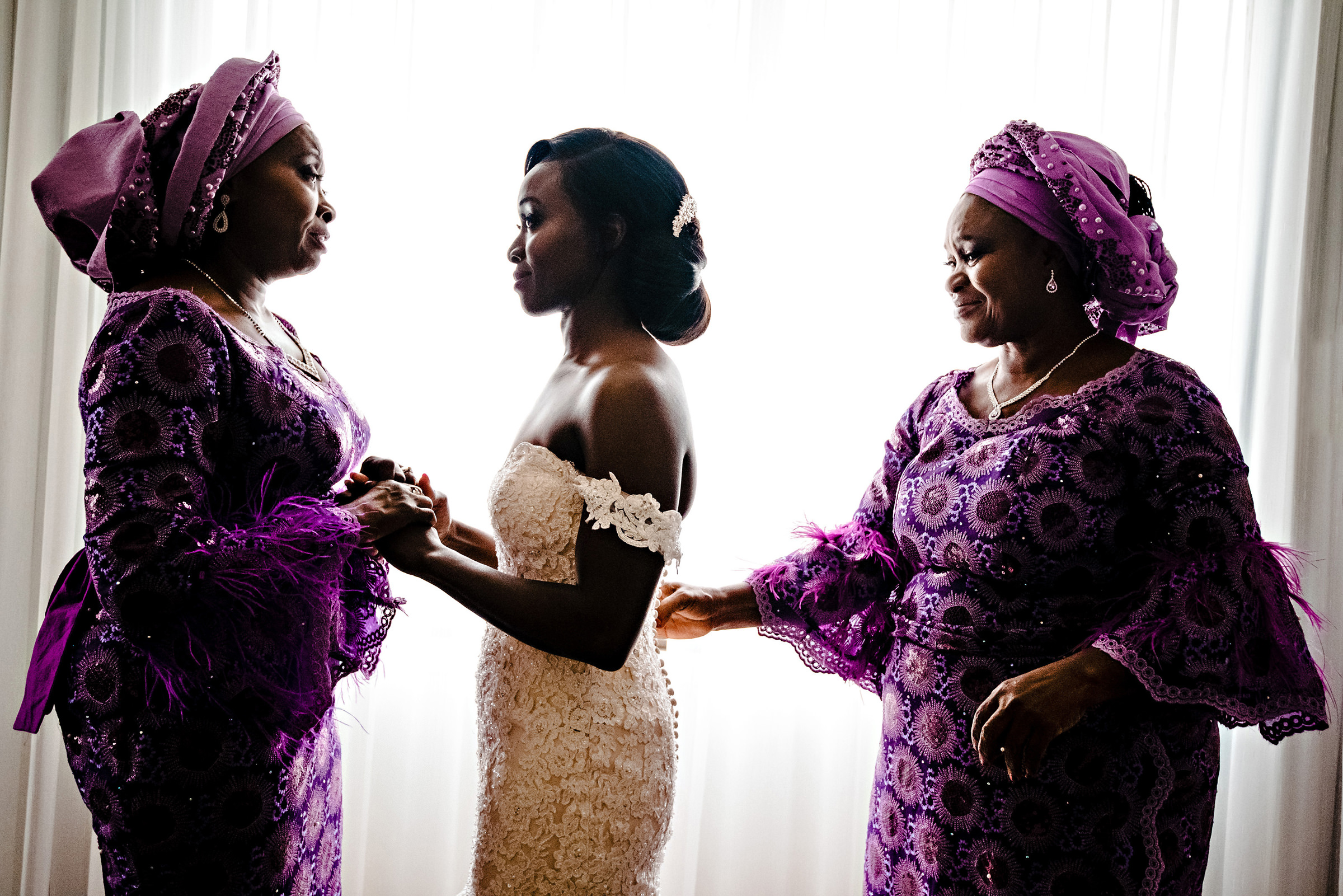 Bride between two female family members - photo by Moore Photography