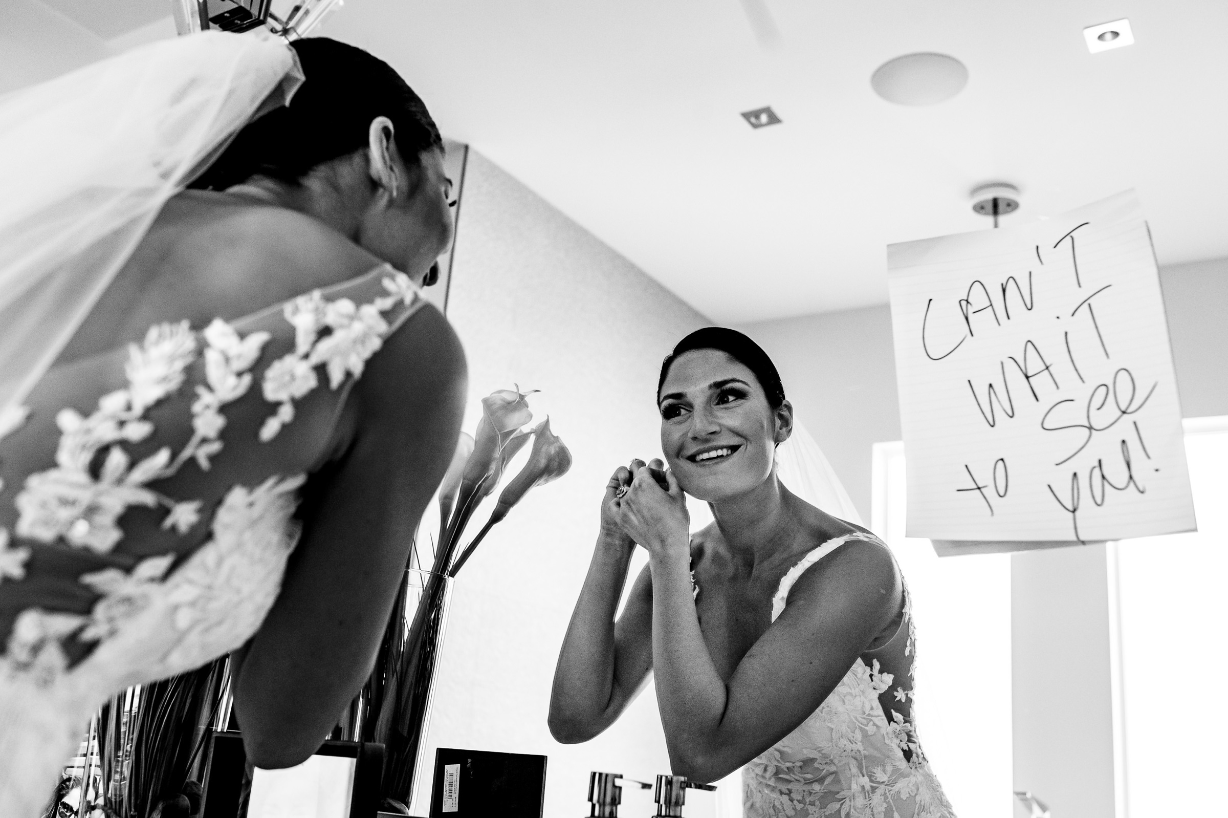 Bride in mirror with handwritten sign cant wait to see you - photo by Moore Photography