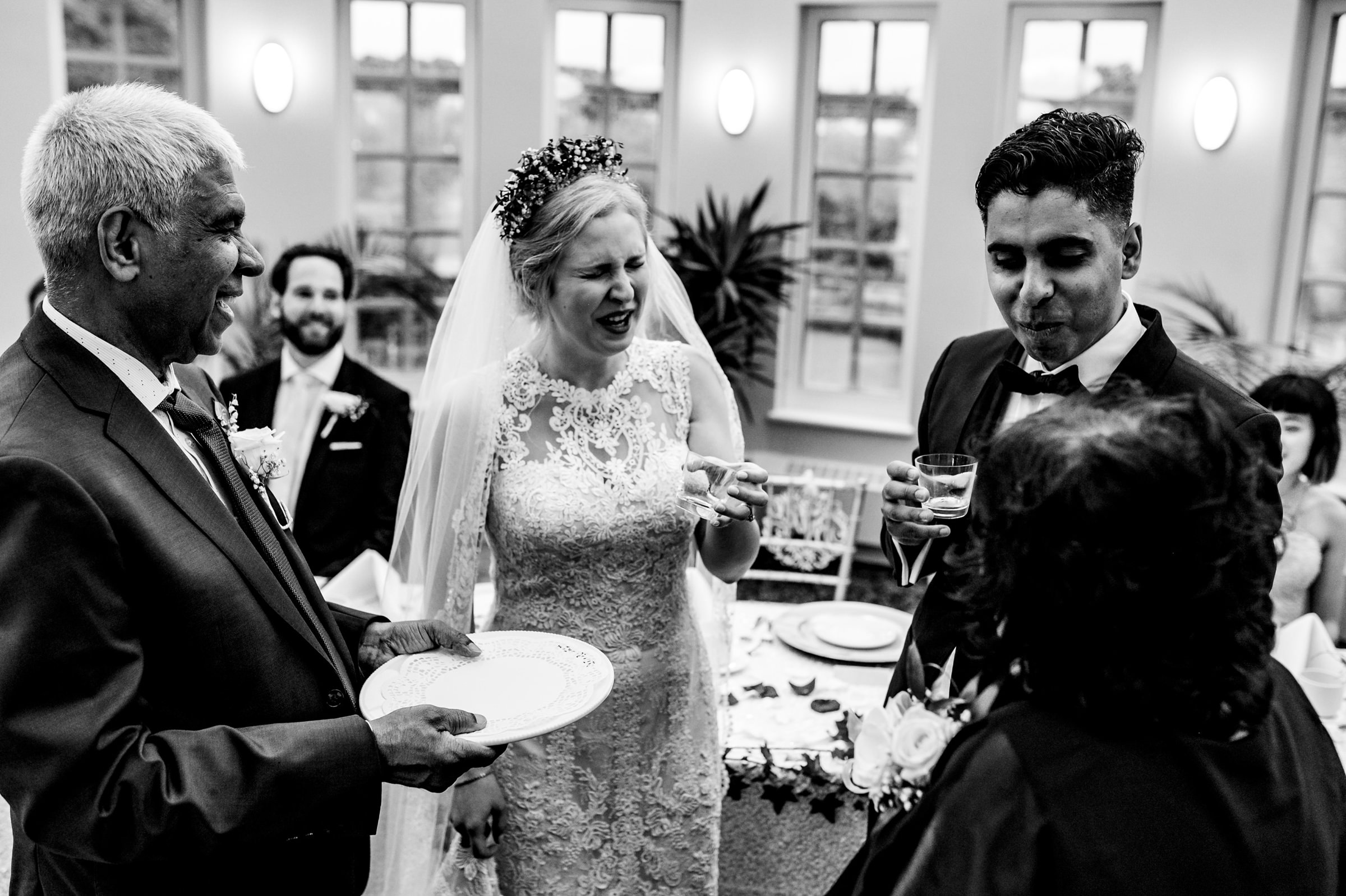 Bride makes funny face with other guests at reception - photo by Moore Photography