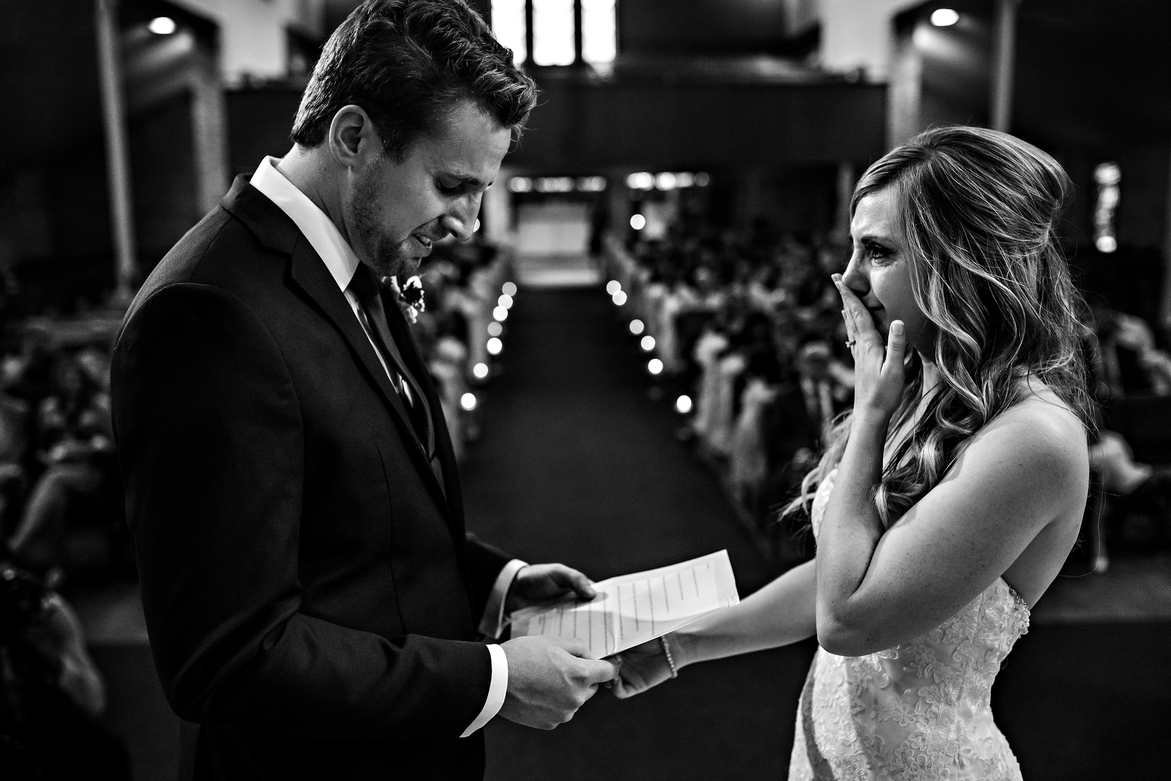 Couple cries during ceremony as they exchange vows - photo by Moore Photography