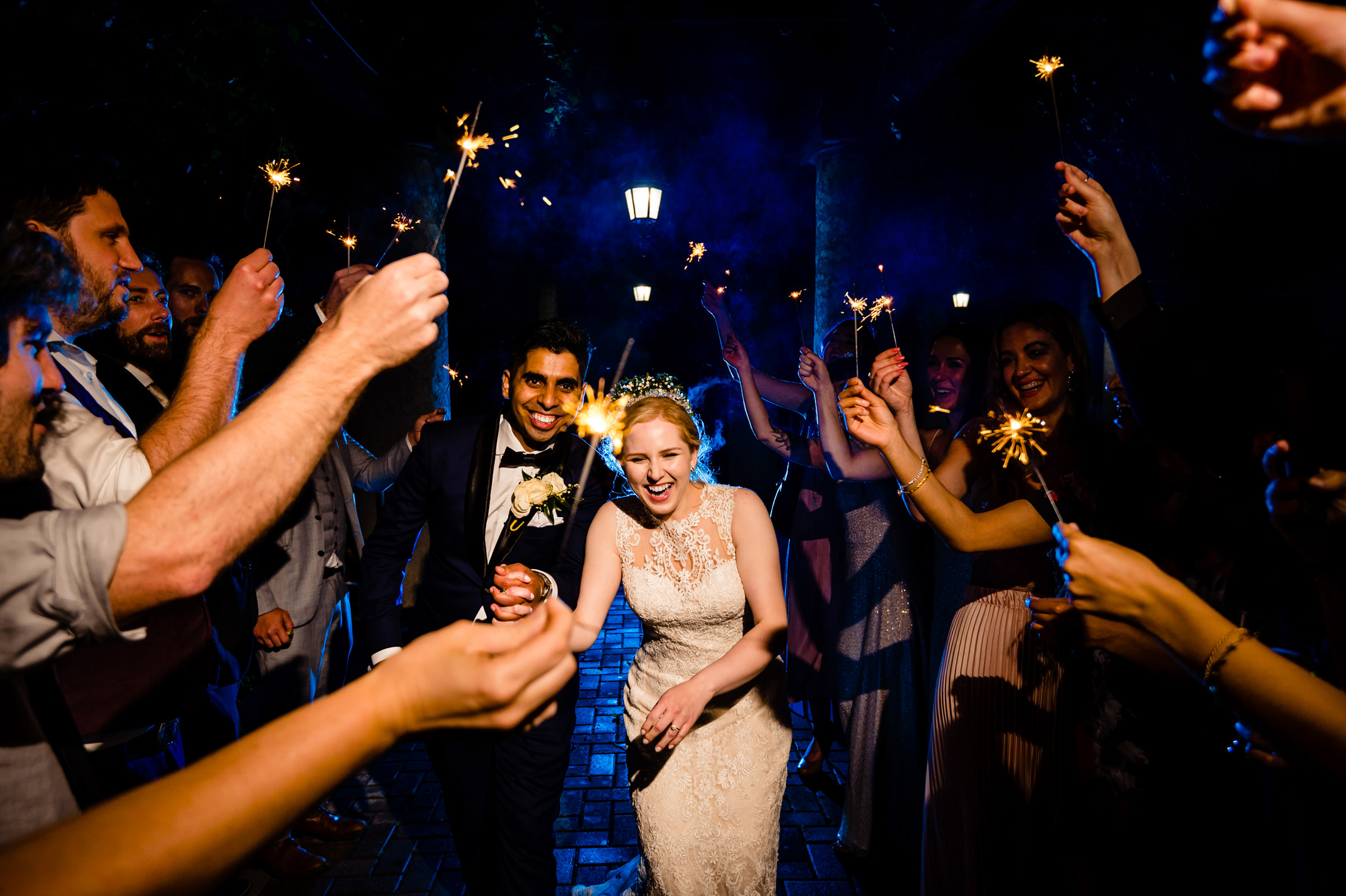 Couple exits through sparklers - photo by Moore Photography