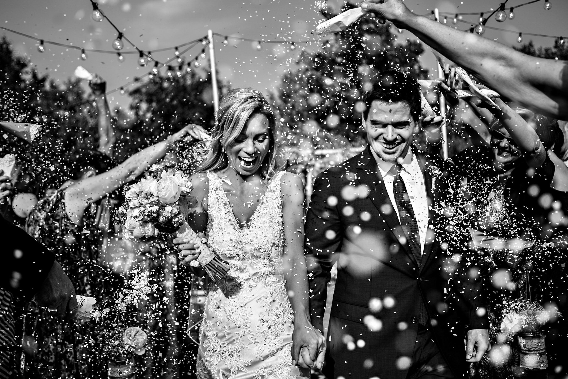 Couple showered in rice while leaving ceremony - photo by Moore Photography
