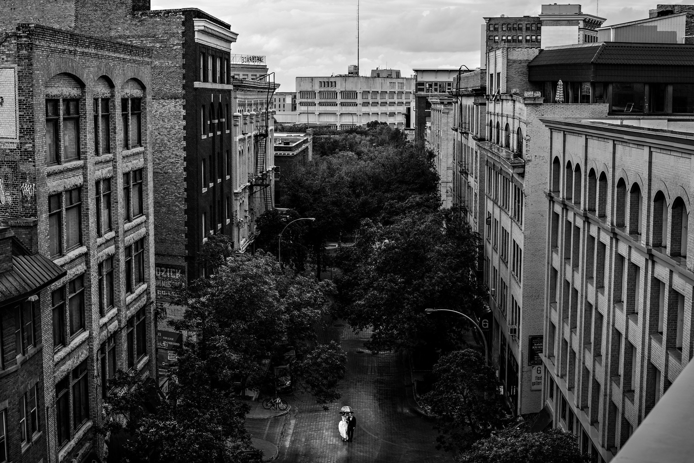 Couple walking in the rain taken from far above - photo by Moore Photography