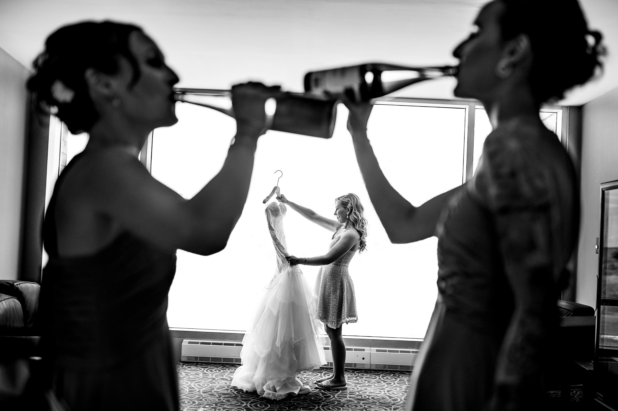 Creative composition of bride and reflected guest - photo by Moore Photography