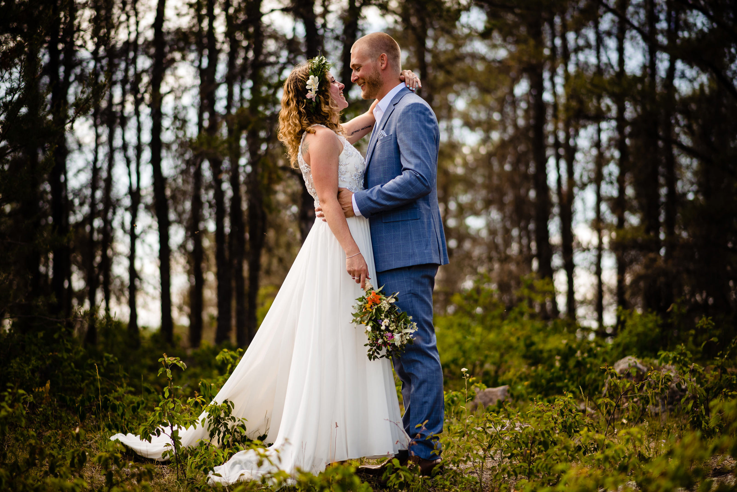 Face to face portrait of couple in the forest - photo by Moore Photography