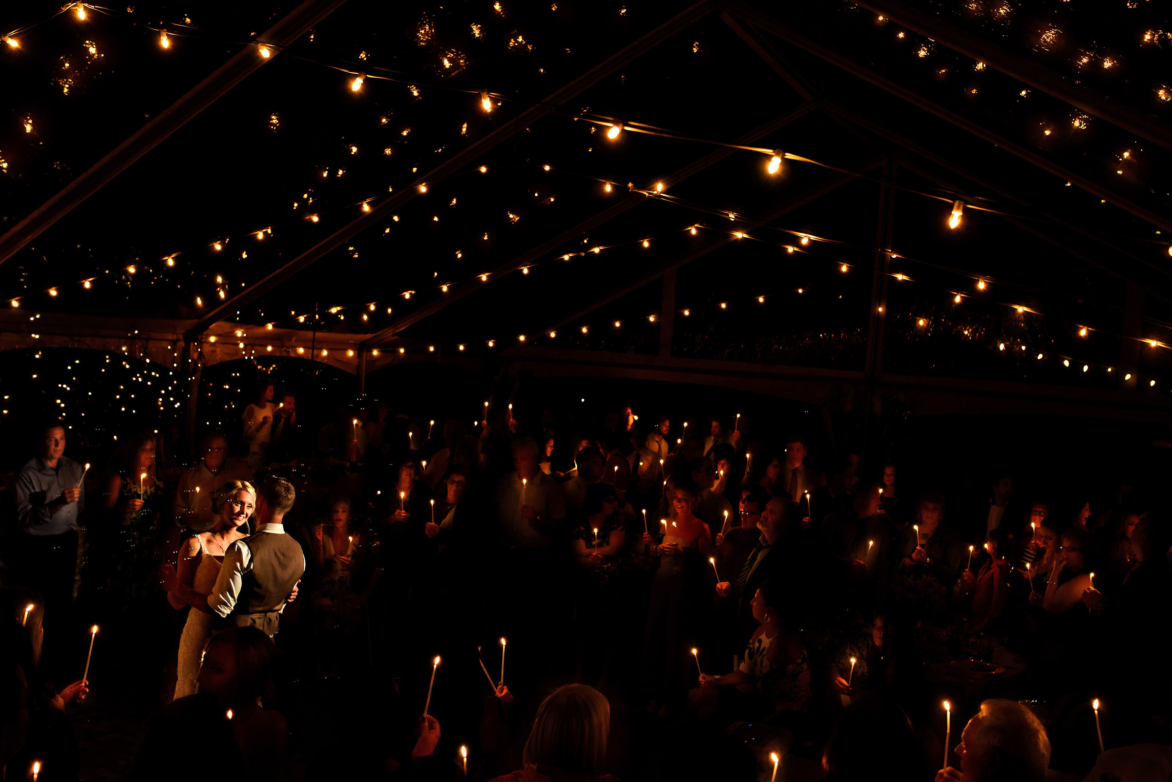 First dance lit by guests holding candles - photo by Moore Photography