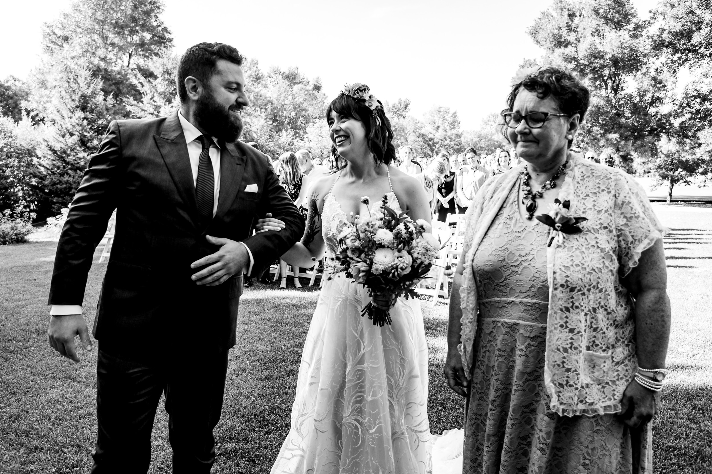 Groom and bride with mother at outdoor ceremony - photo by Moore Photography