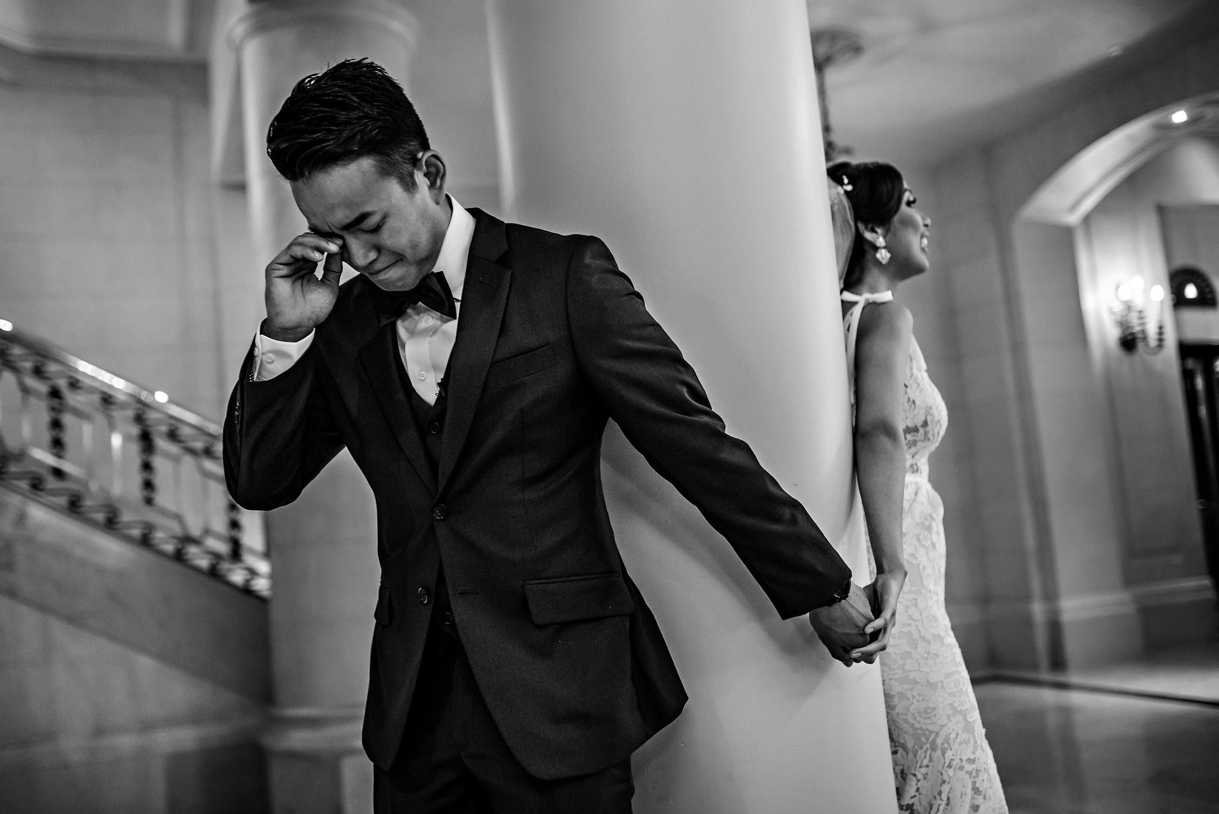 groom cries before seeing bride at first look - photo by Moore Photography