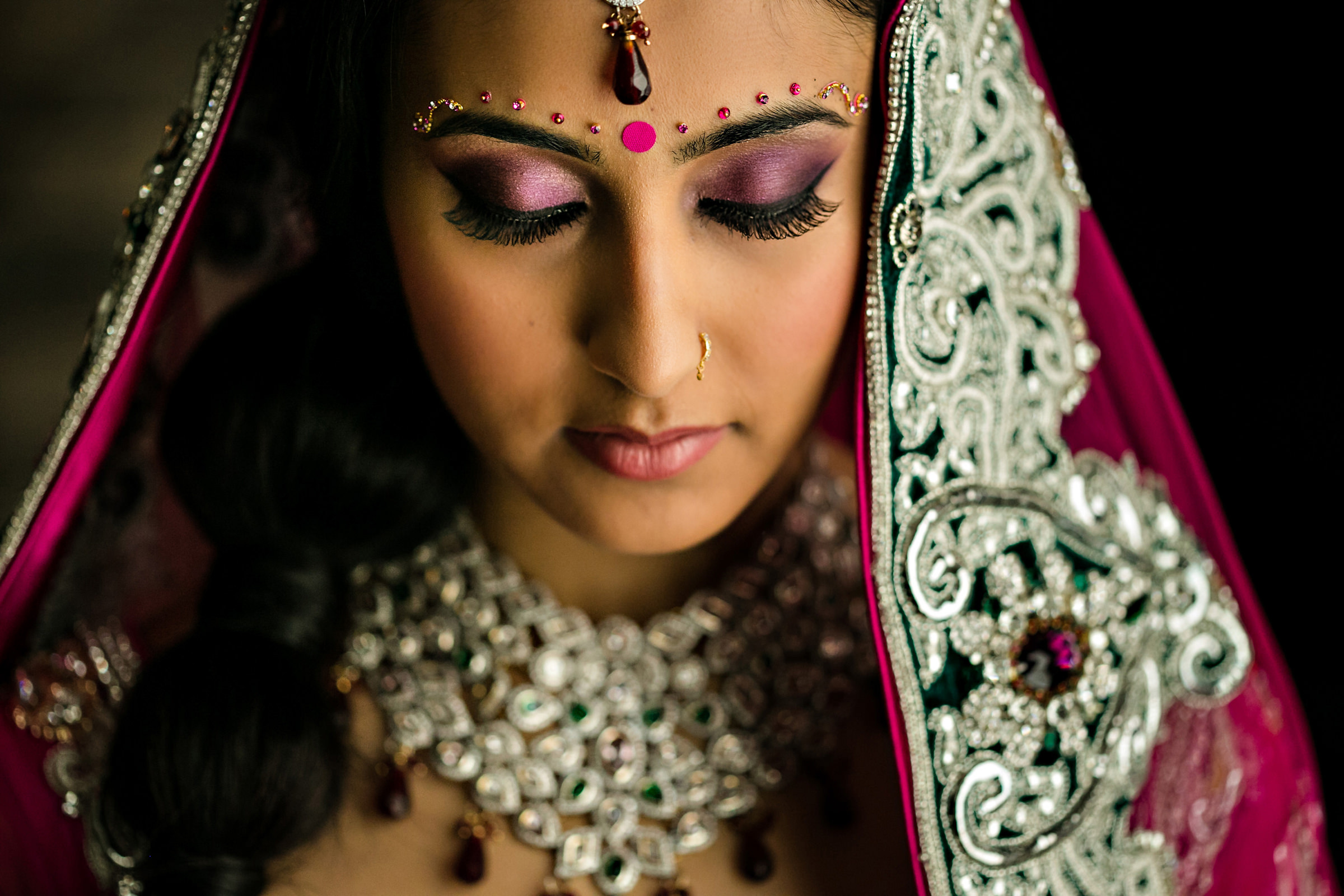 Indian Bride with magneta beaded veil - photo by Moore Photography
