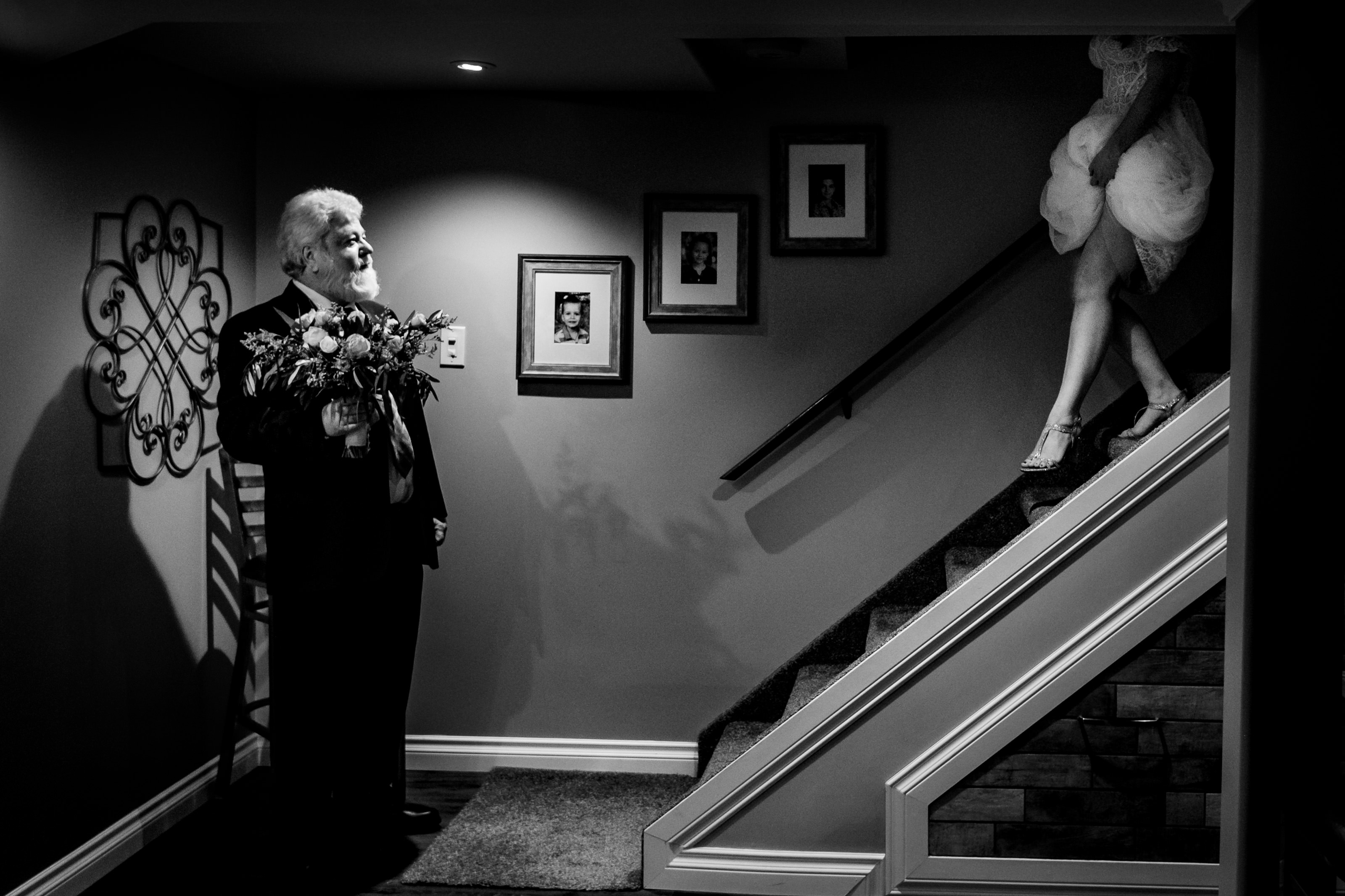Bride walking down stairs to see dad - photo by Moore Photography