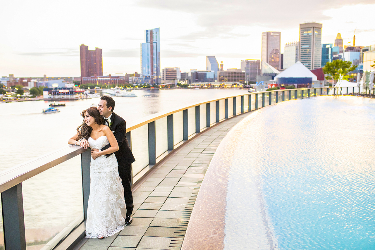 Couple on urban waterfront - photo by Anna Schmidt Photography
