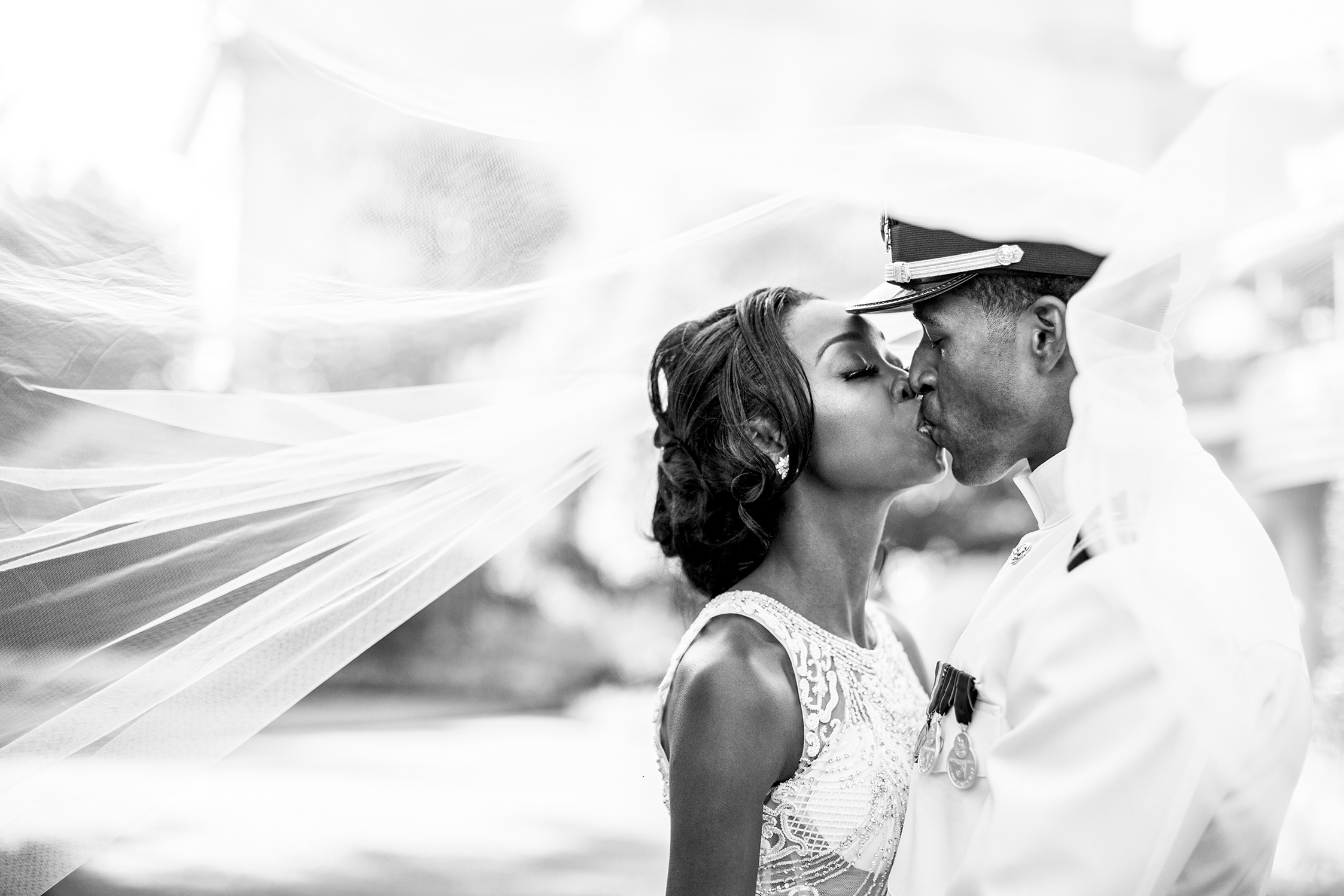 Military couple kiss - photo by Anna Schmidt Photography