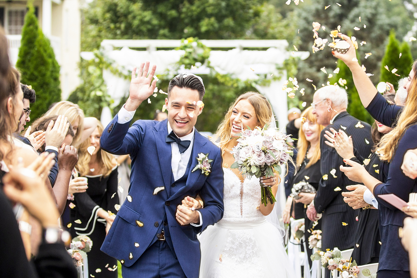 Outdoor recessional to rose petals - photo by Anna Schmidt Photography