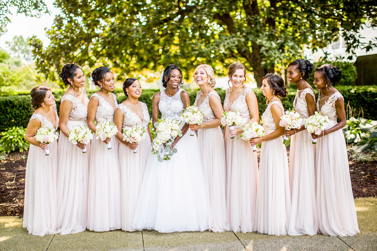Bride with bridal party outdoor pose - photo by Anna Schmidt Photography