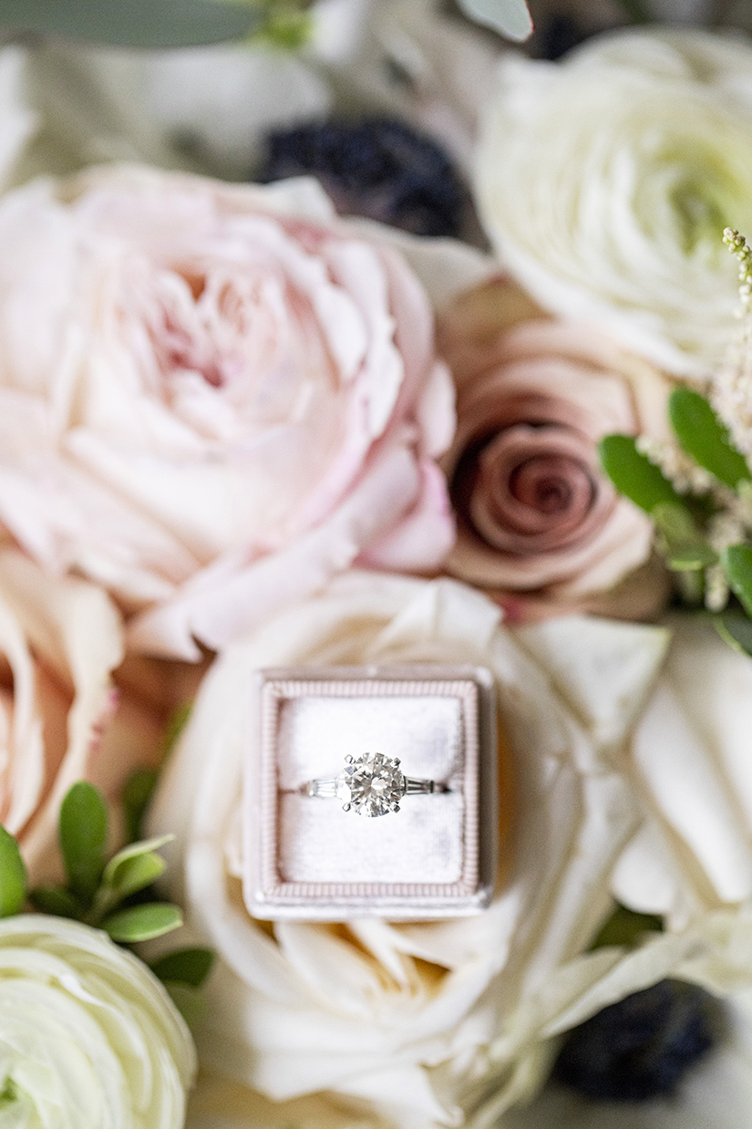 Detail of ring in box against pink roses - photo by Anna Schmidt Photography