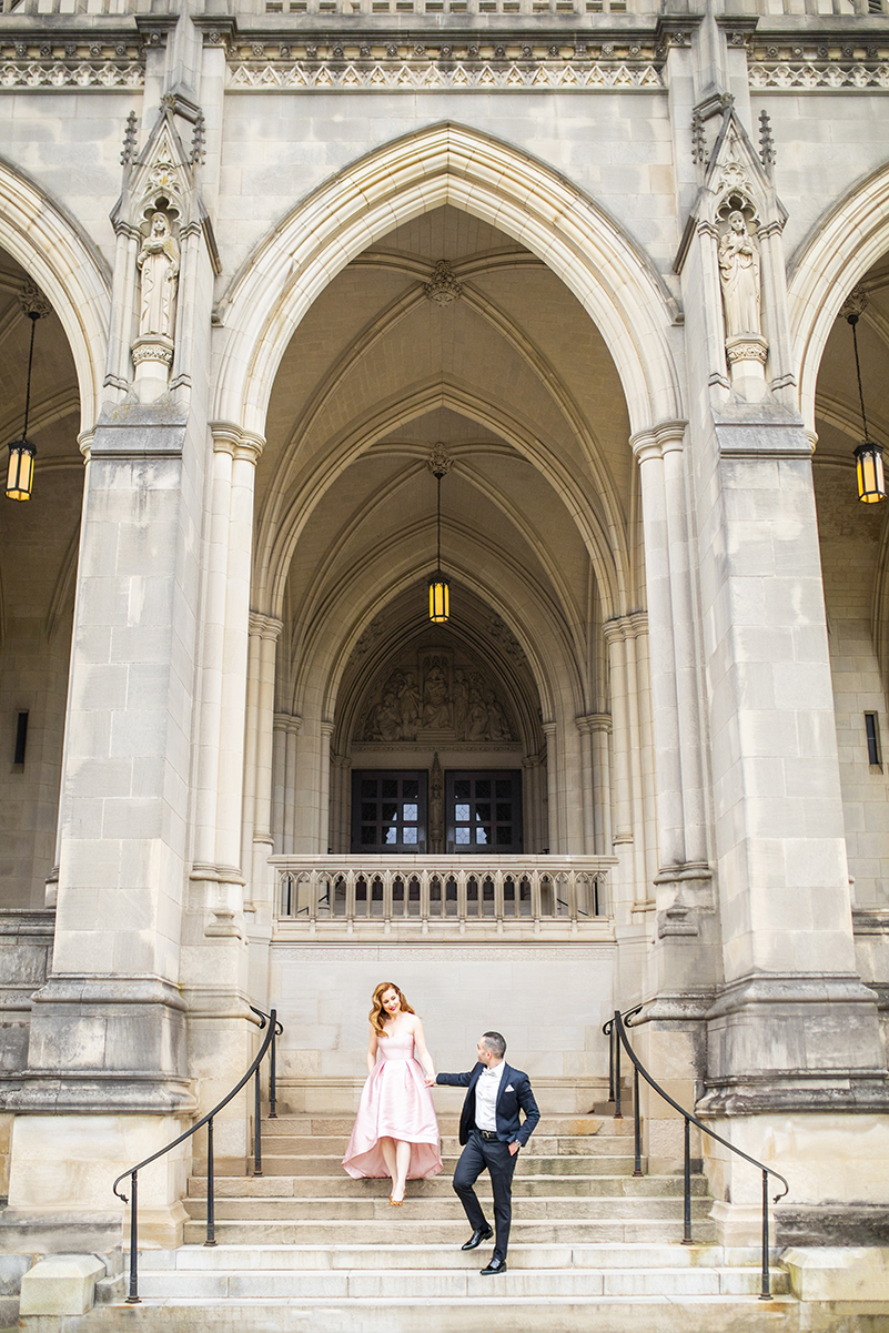 Engagement couple descend historic staircase - photo by Anna Schmidt Photography