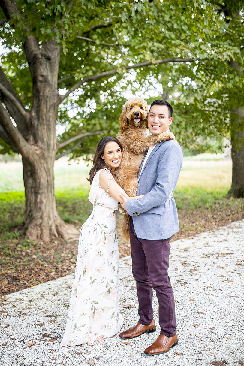 Engagement photo of bride and groom with dog - photo by Anna Schmidt Photography