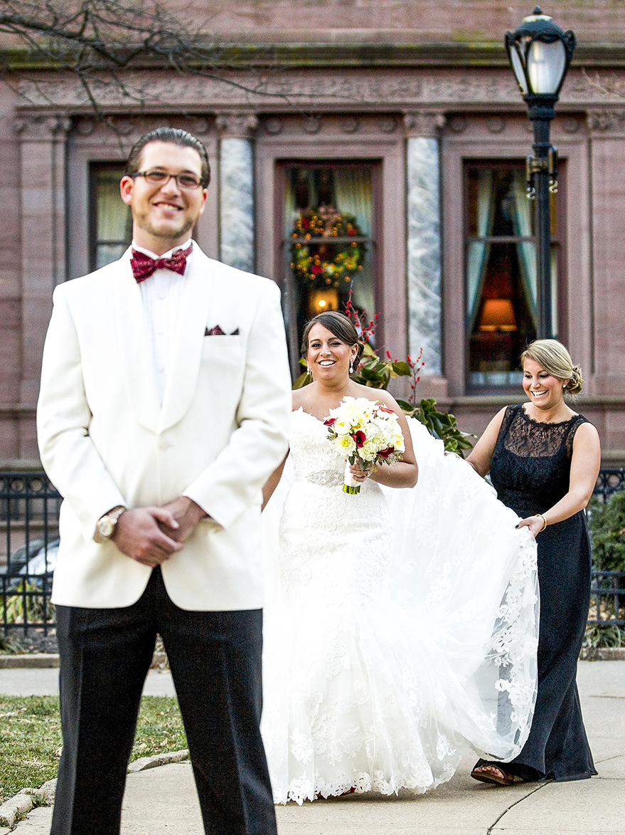 First look with bride and bridesmaid behind groom - photo by Anna Schmidt Photography
