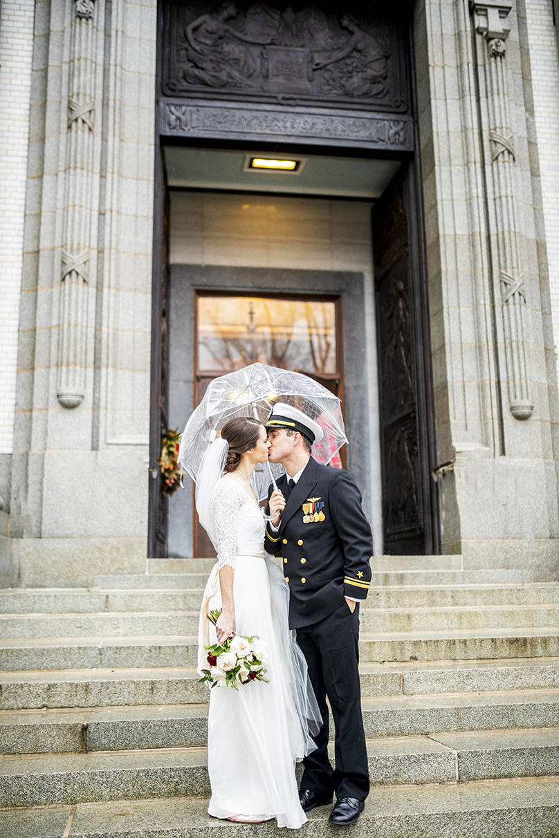 Military wedding kiss under umbrella  - photo by Anna Schmidt Photography