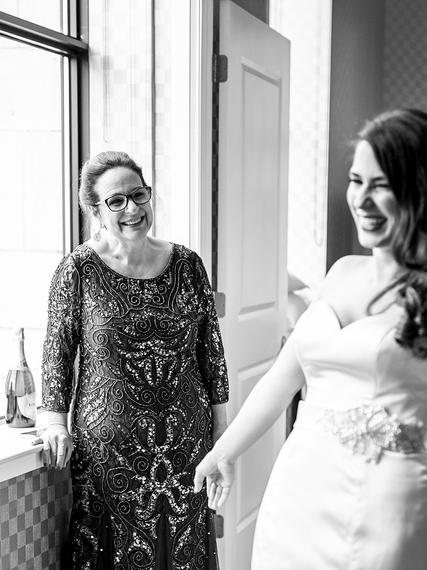 Mom looks at bride proudly - photo by Anna Schmidt Photography