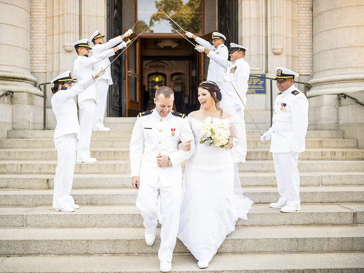 Naval wedding couple exiting down stairs - photo by Anna Schmidt Photography