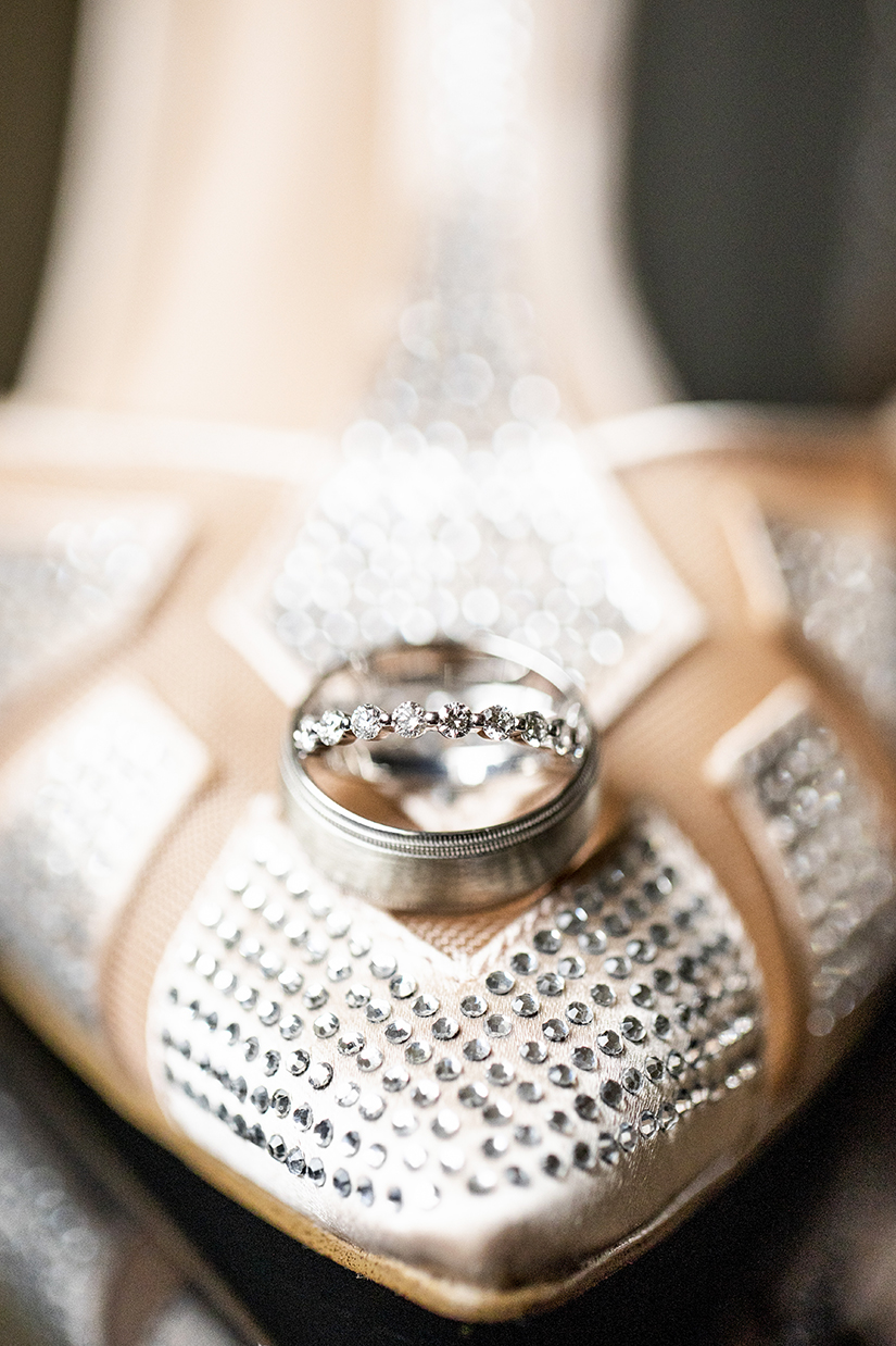 Rings nestled on jeweled bridal shoe - photo by Anna Schmidt Photography