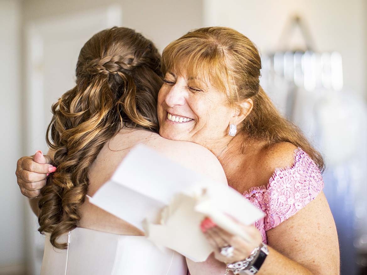 Sweet mother bride embrace featuring mother - photo by Anna Schmidt Photography