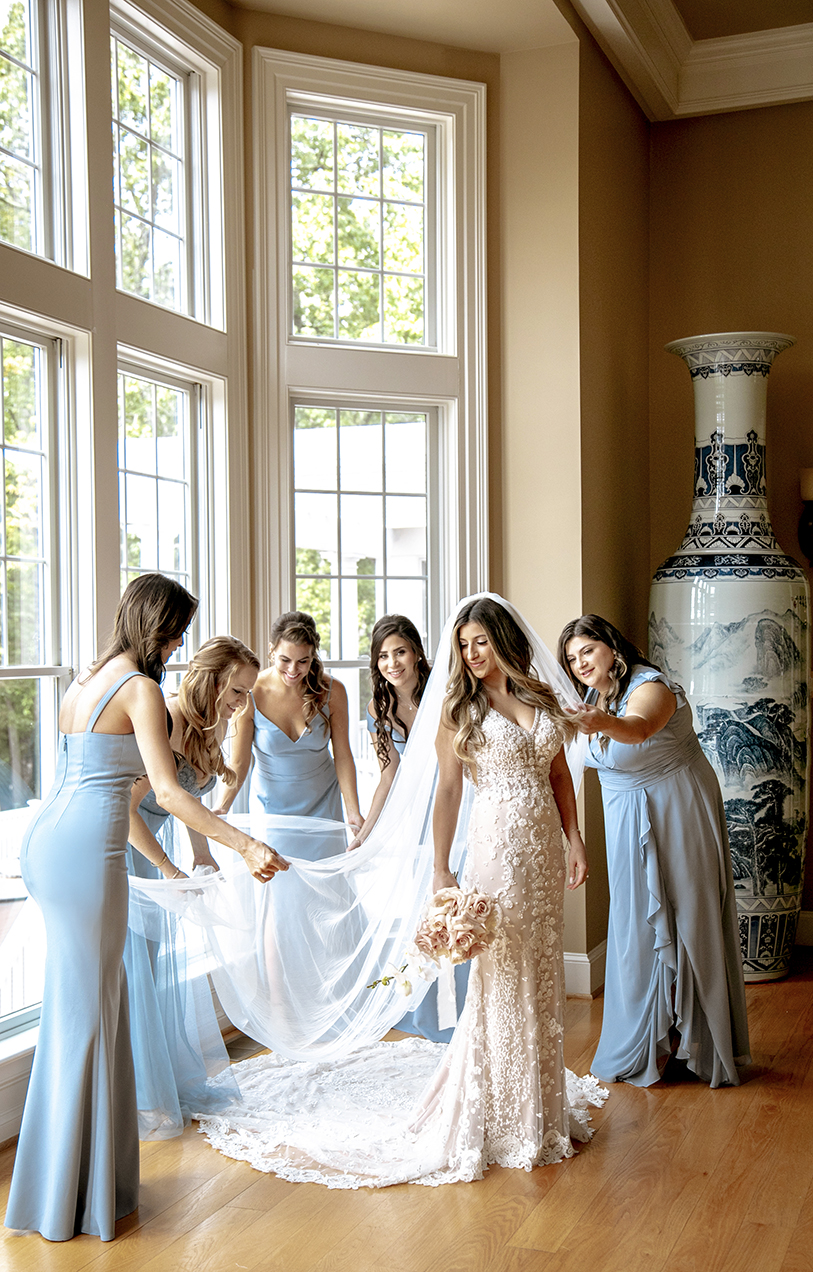 Bride and bridesmaids in window light - photo by Anna Schmidt Photography
