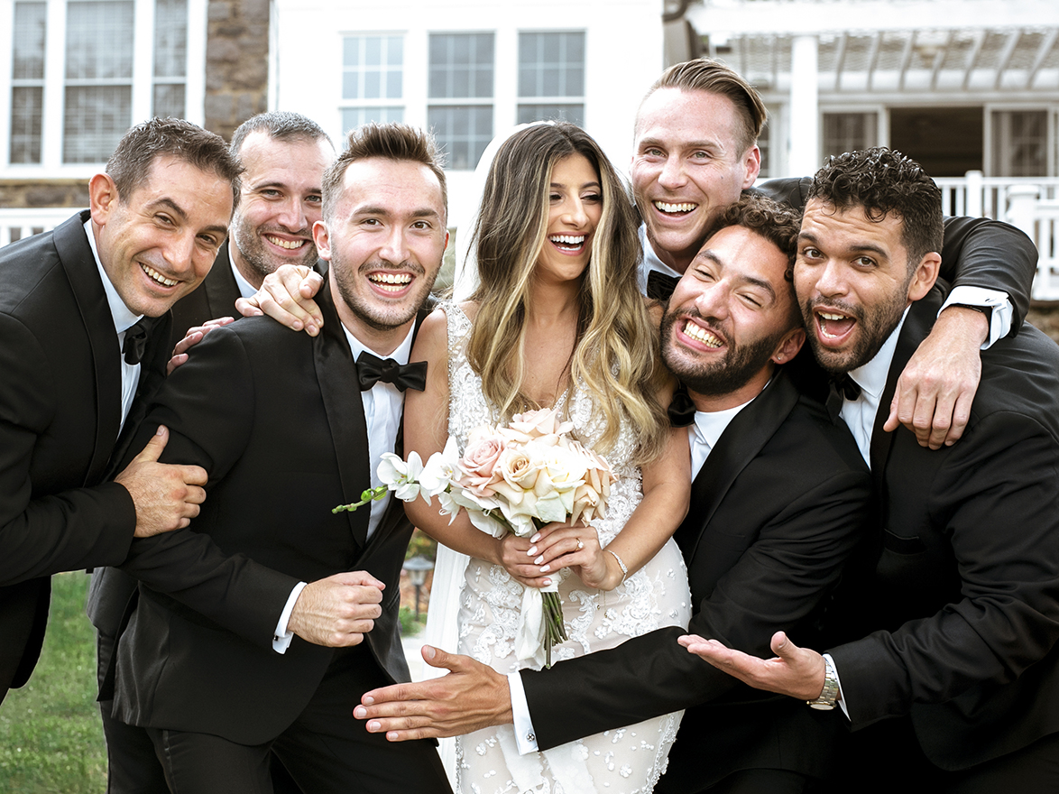 Fun photo of bride with groom and groomsmen - photo by Anna Schmidt Photography