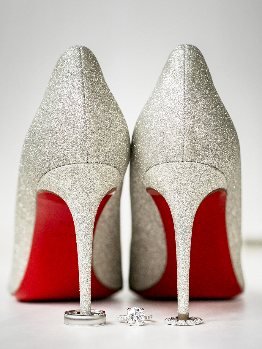 sparkly silver heels with bright red soles- photo by Anna Schmidt Photography
