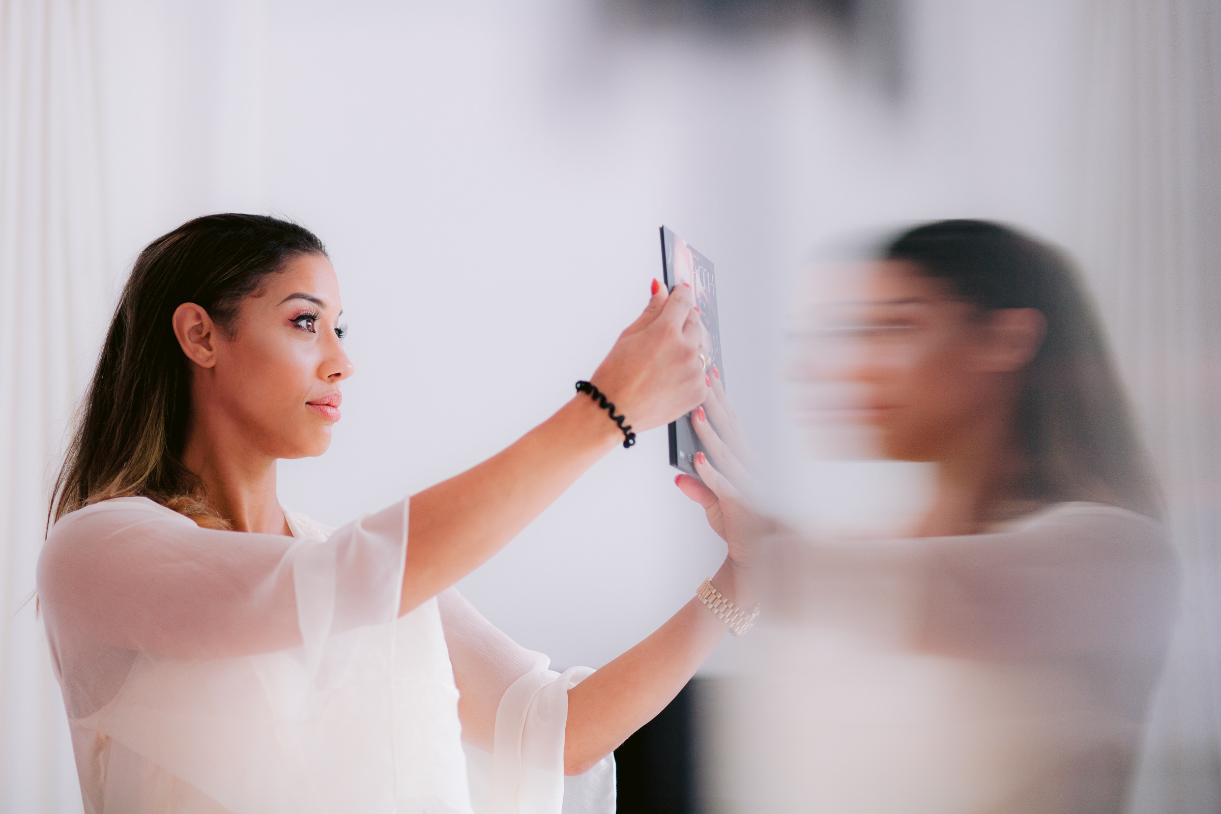 Bride with hand mirror blurred reflection - photo by Peter van der Lingen Wedding Photography