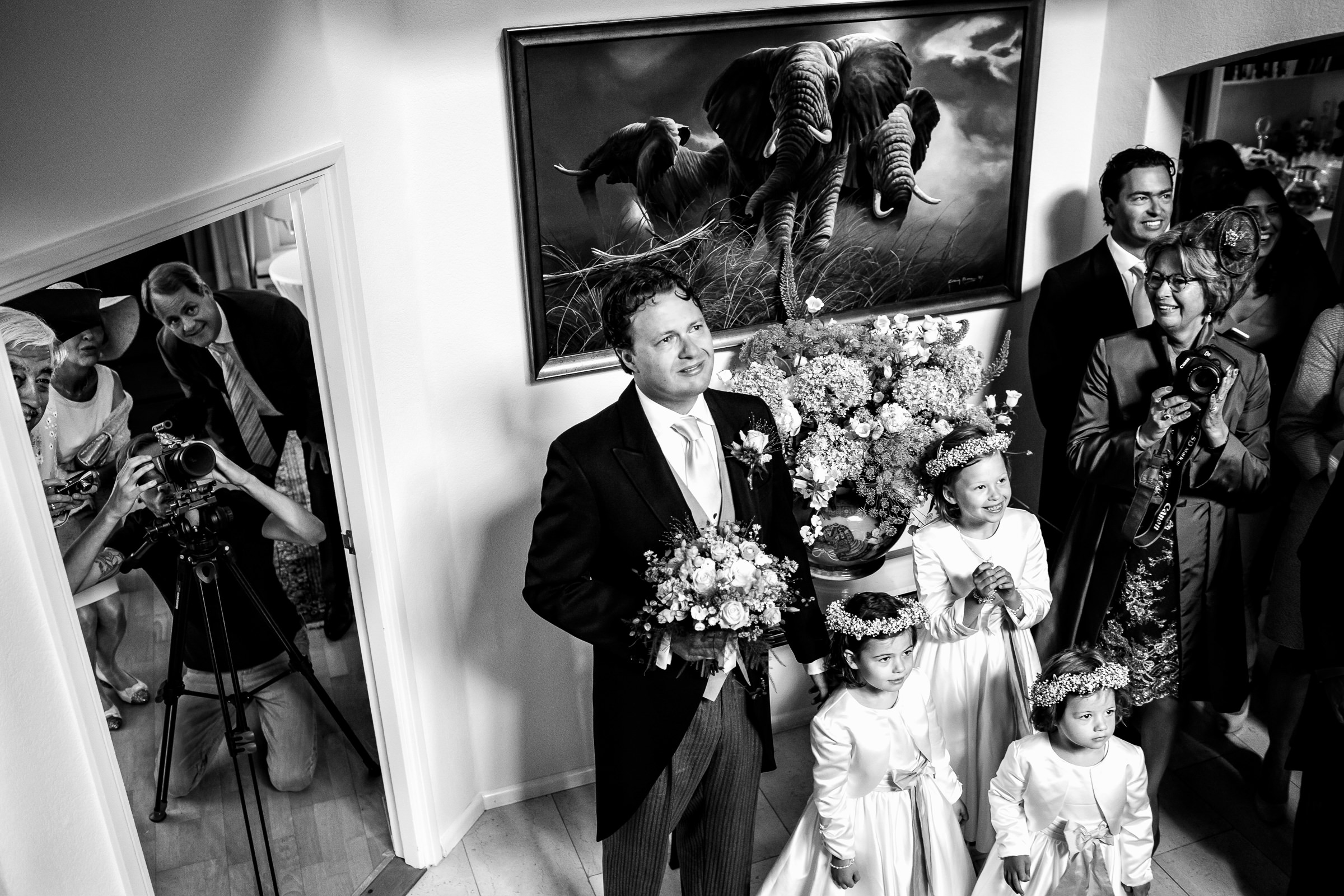 Photo of photographers taking group shot with groom and flower girls - photo by Peter van der Lingen Wedding Photography