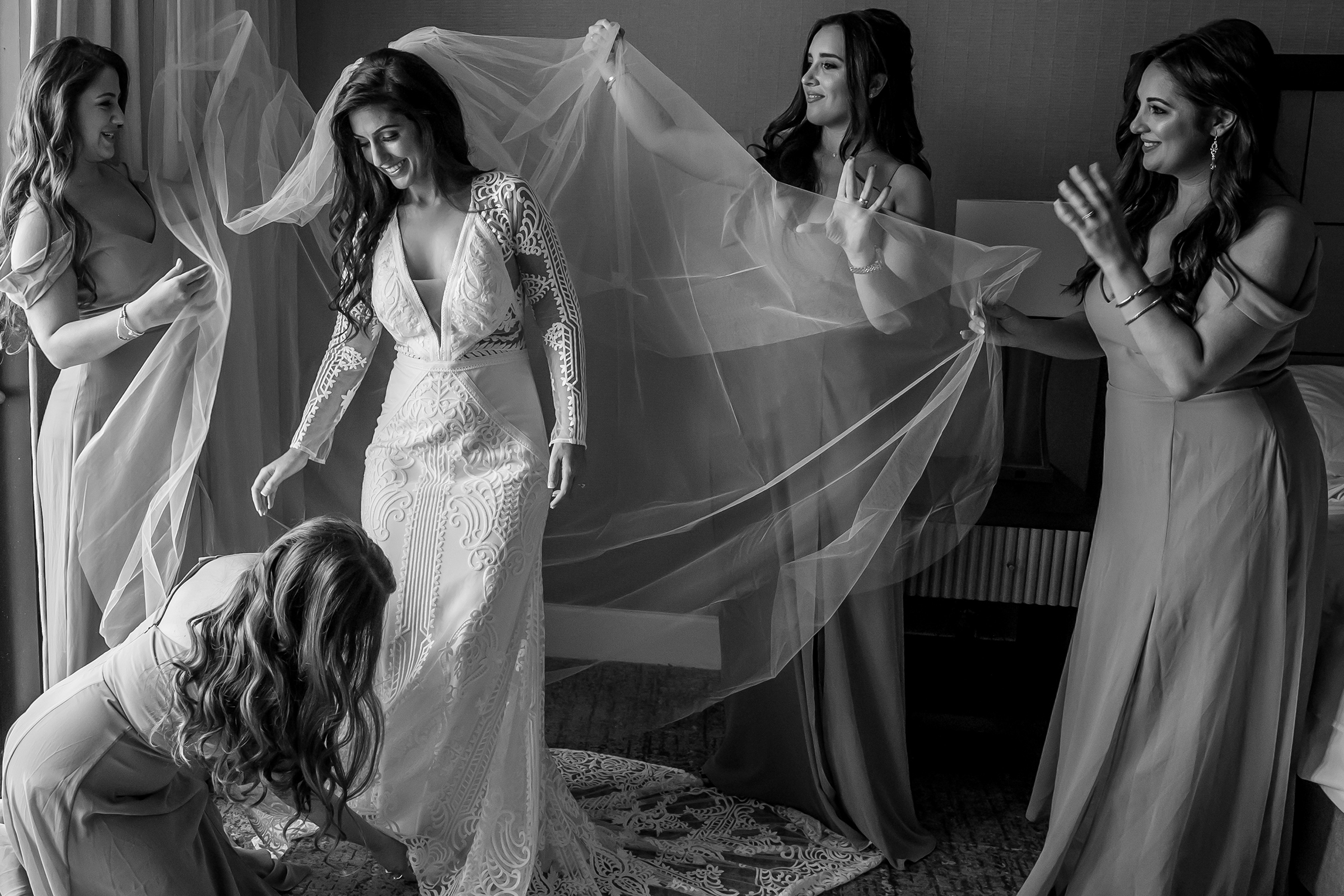 adjusting the brides train and veil - photo by Gloria Ruth Photography