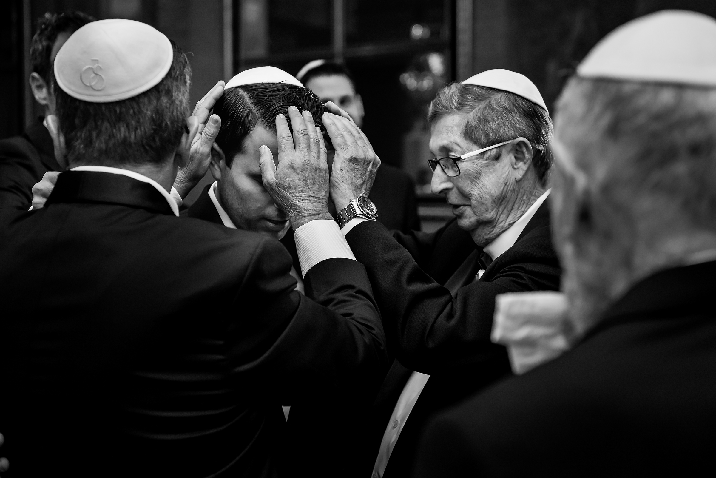 Blessing the groom - photo by Gloria Ruth Photography
