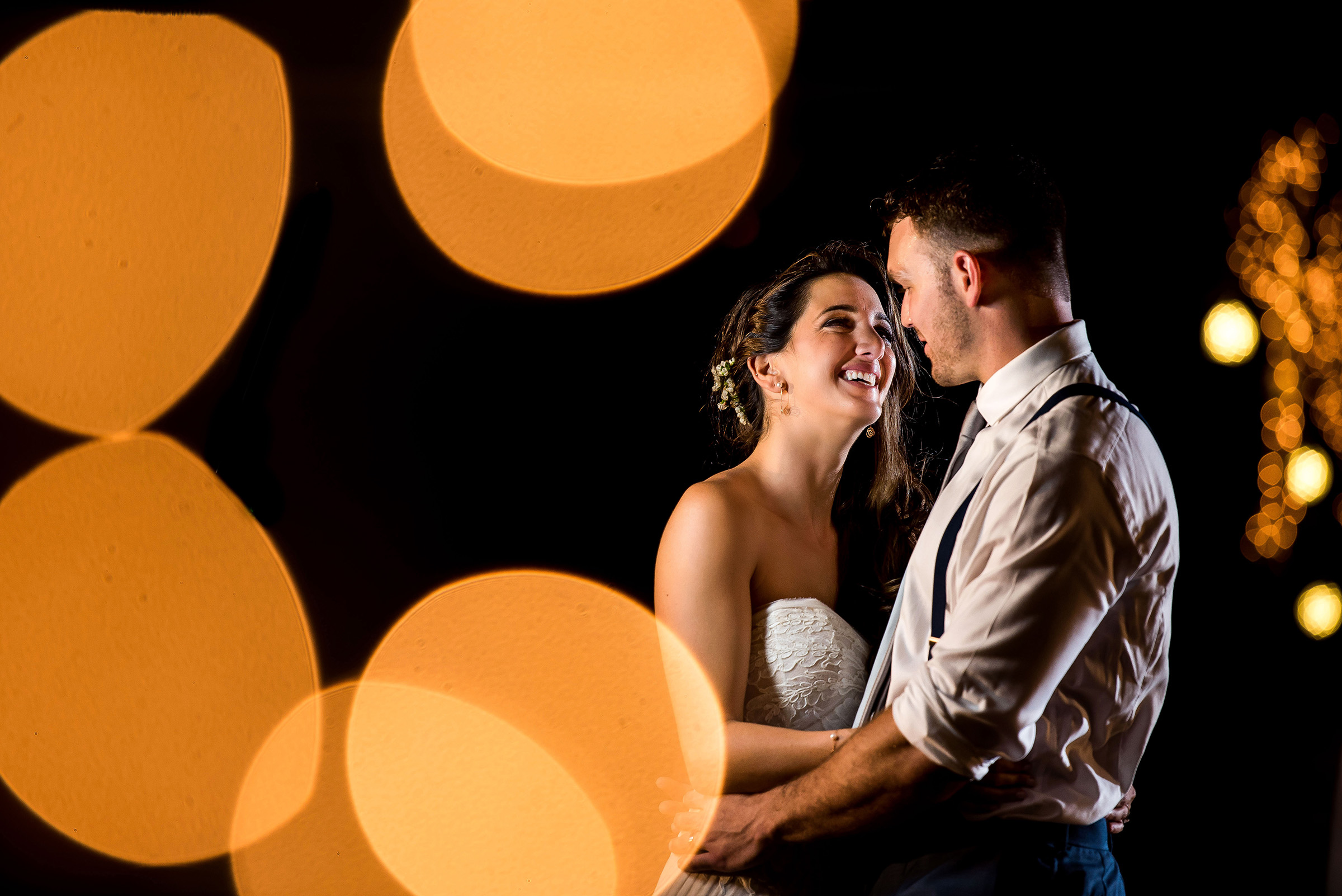 Bokeh portrait of couple dancing - photo by Gloria Ruth Photography