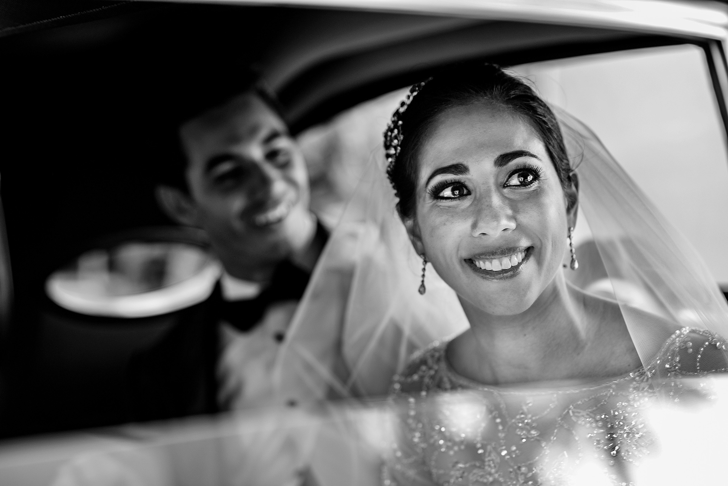 Bride and groom through limo window - photo by Gloria Ruth Photography
