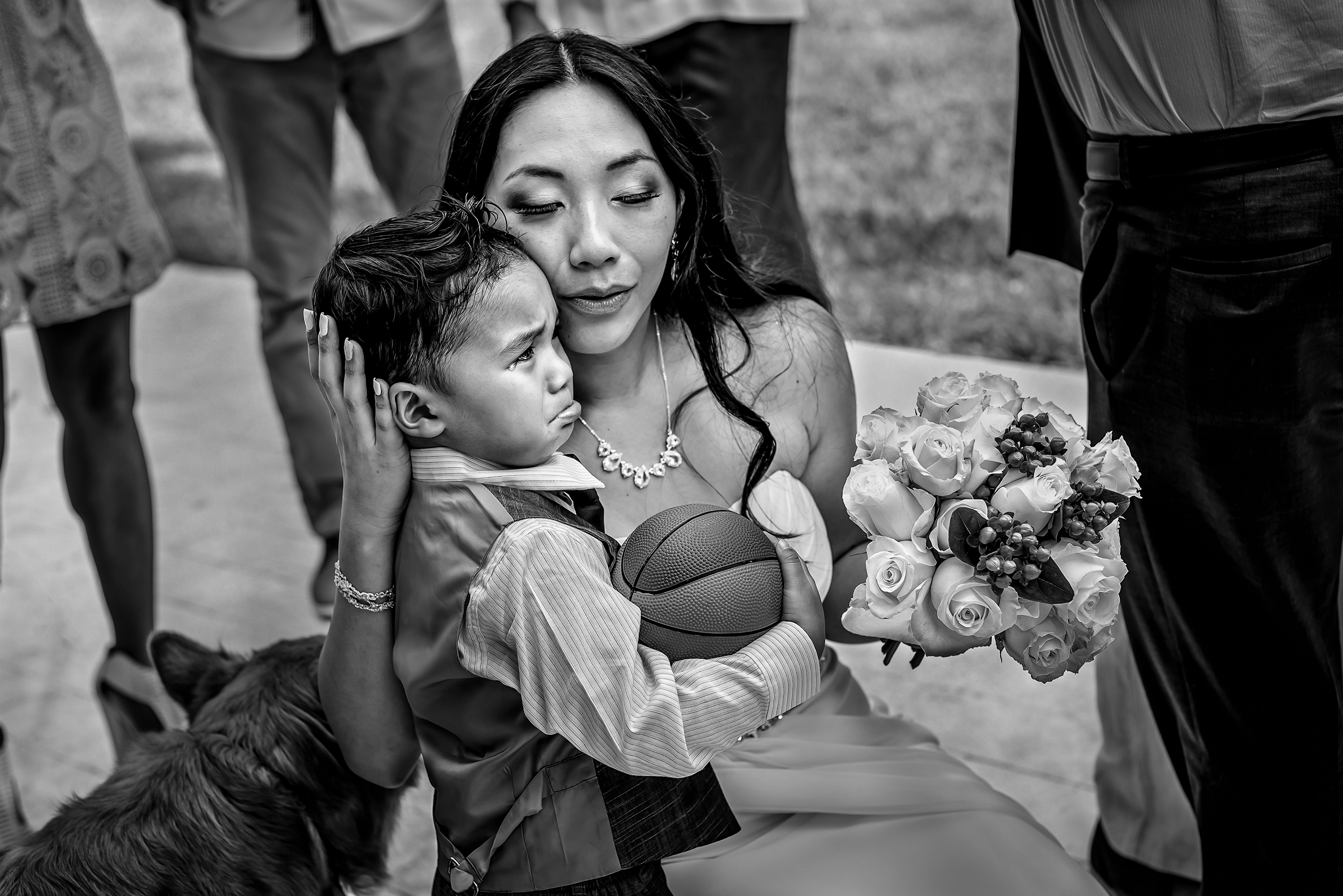 Bride comforting little boy - photo by Gloria Ruth Photography