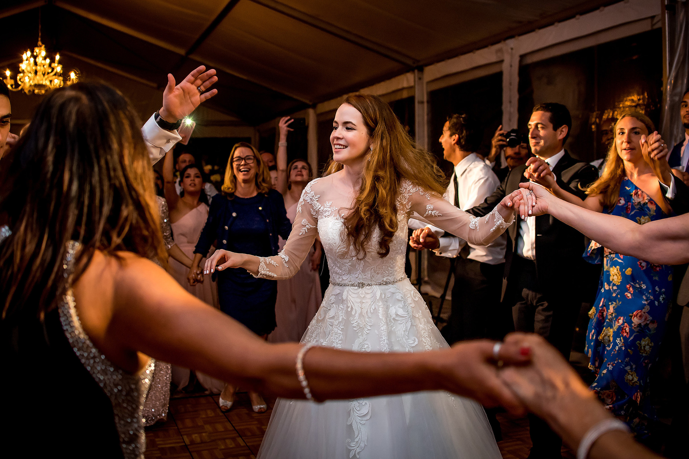 Bride leads circle dance - photo by Gloria Ruth Photography