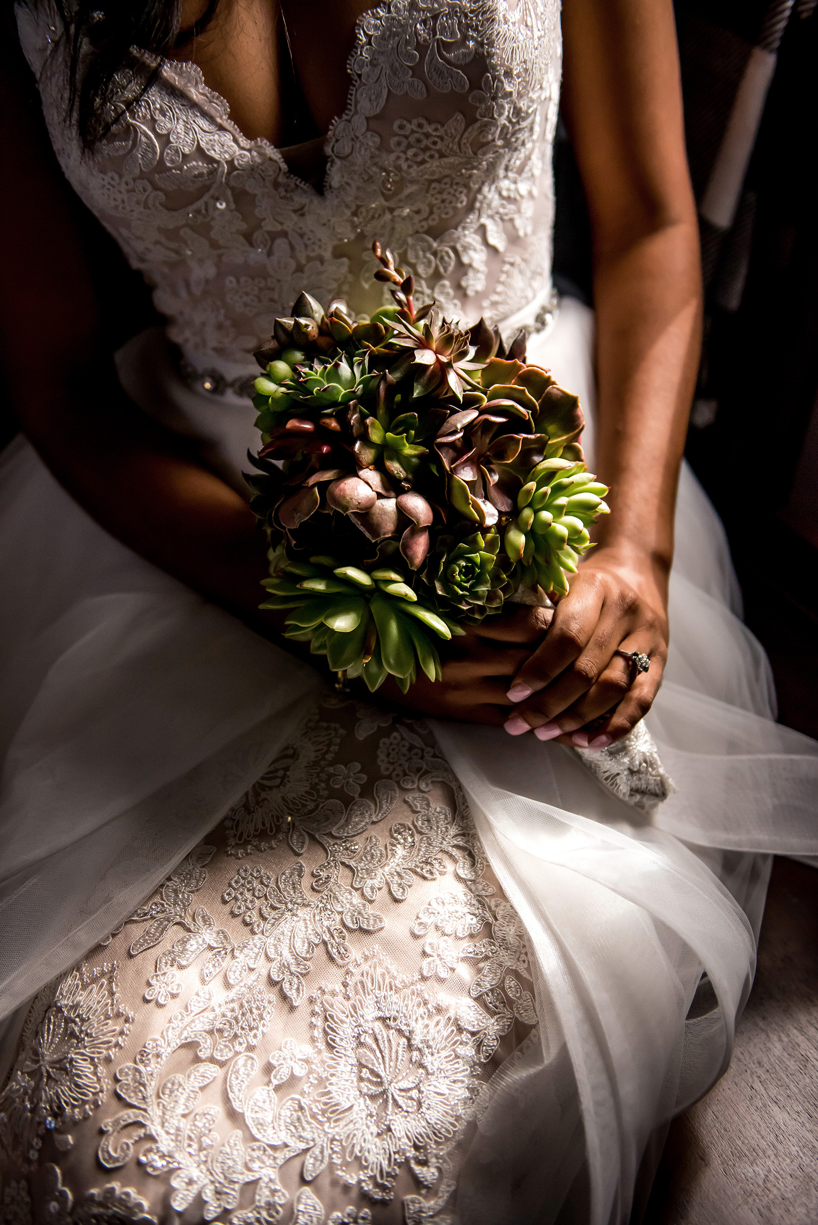 bride with succulent bouquet - photo by Gloria Ruth Photography
