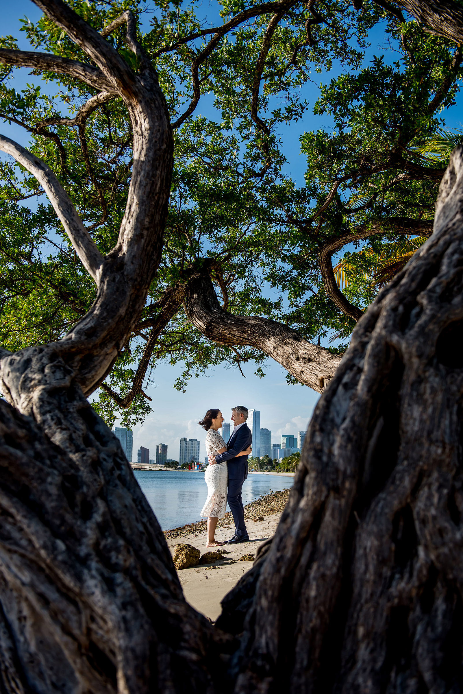 Couple portrait through ancient tree - photo by Gloria Ruth Photography