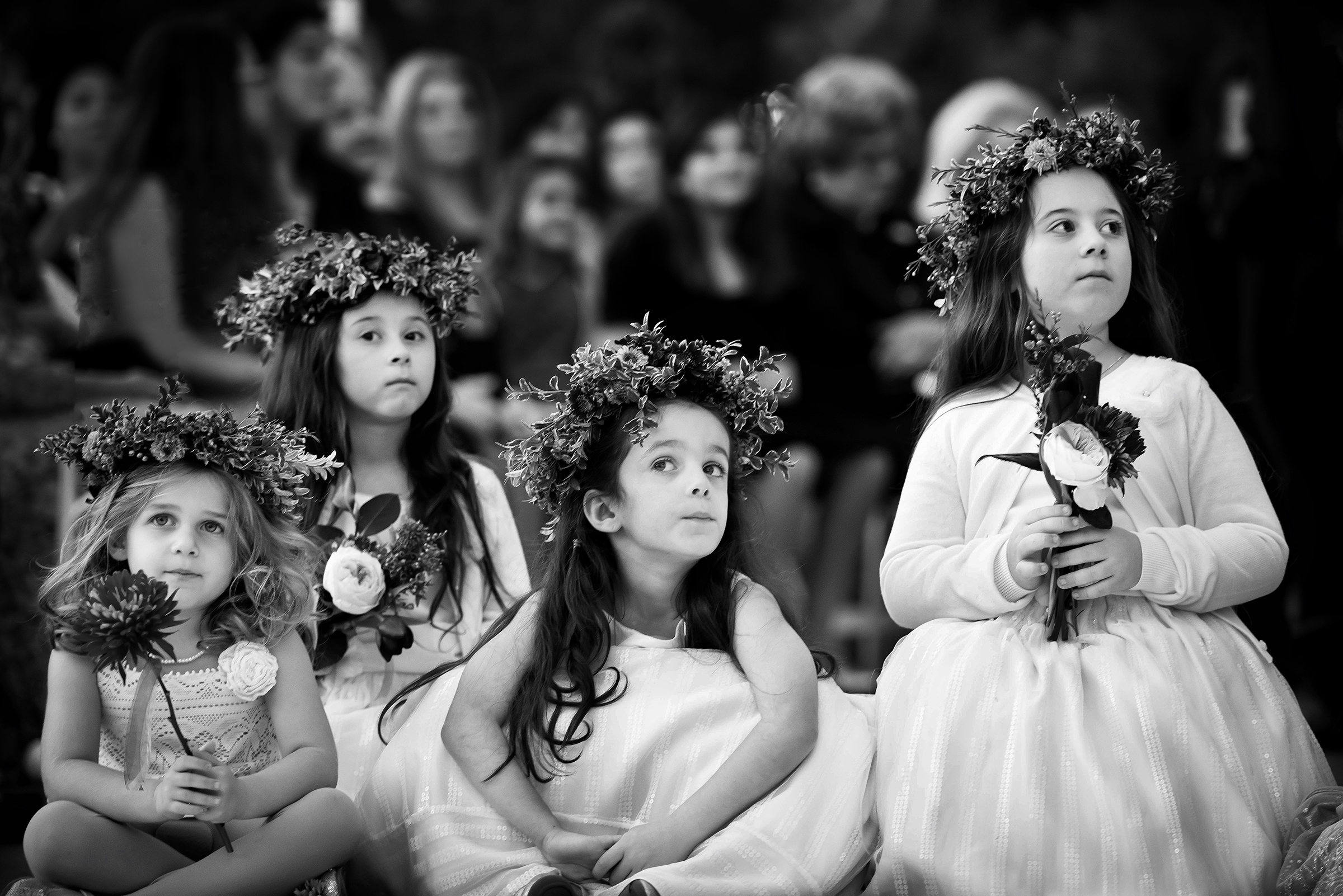 Four flower girls listening - photo by Gloria Ruth Photography