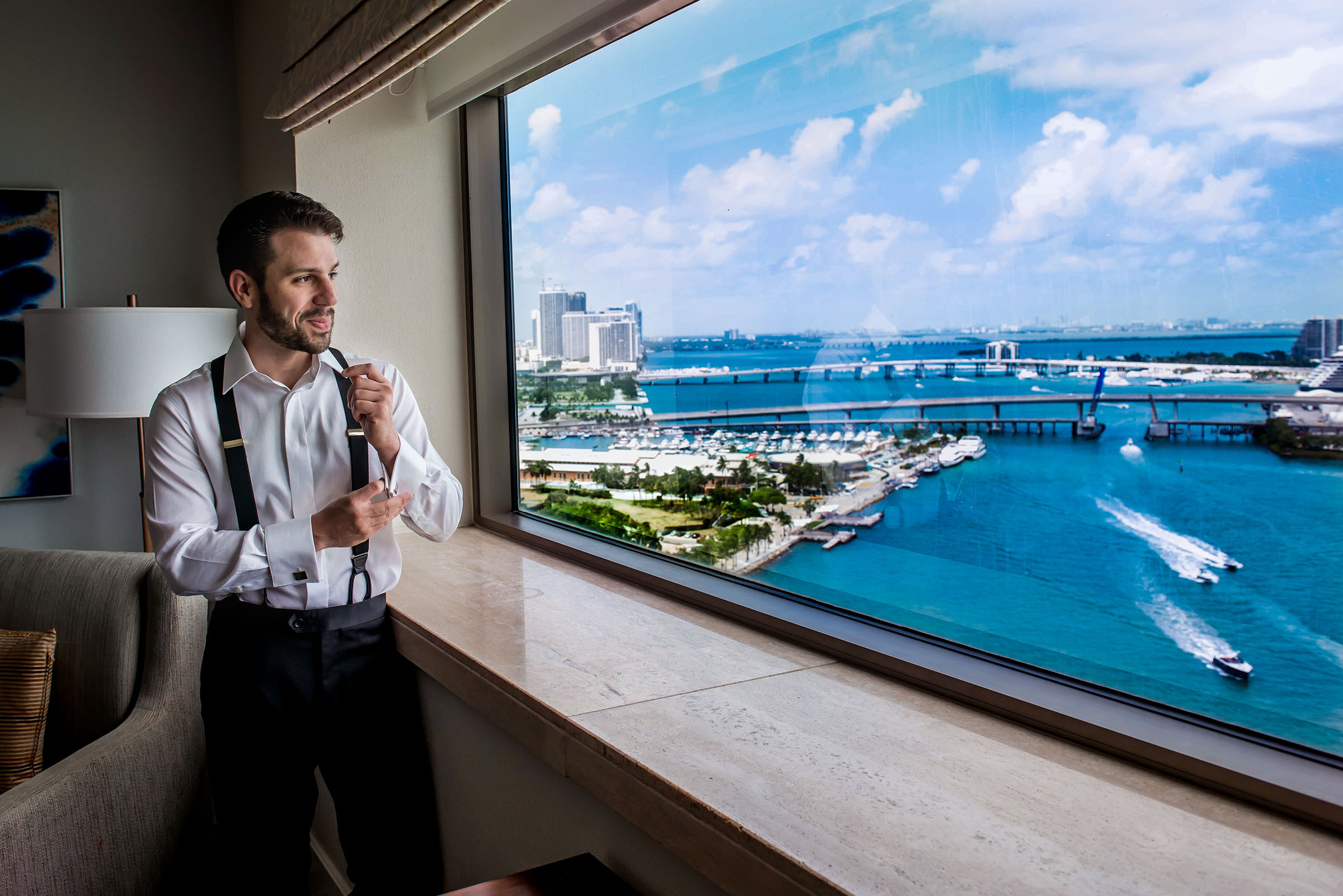 Groom getting read with an urban harbor view - photo by Gloria Ruth Photography