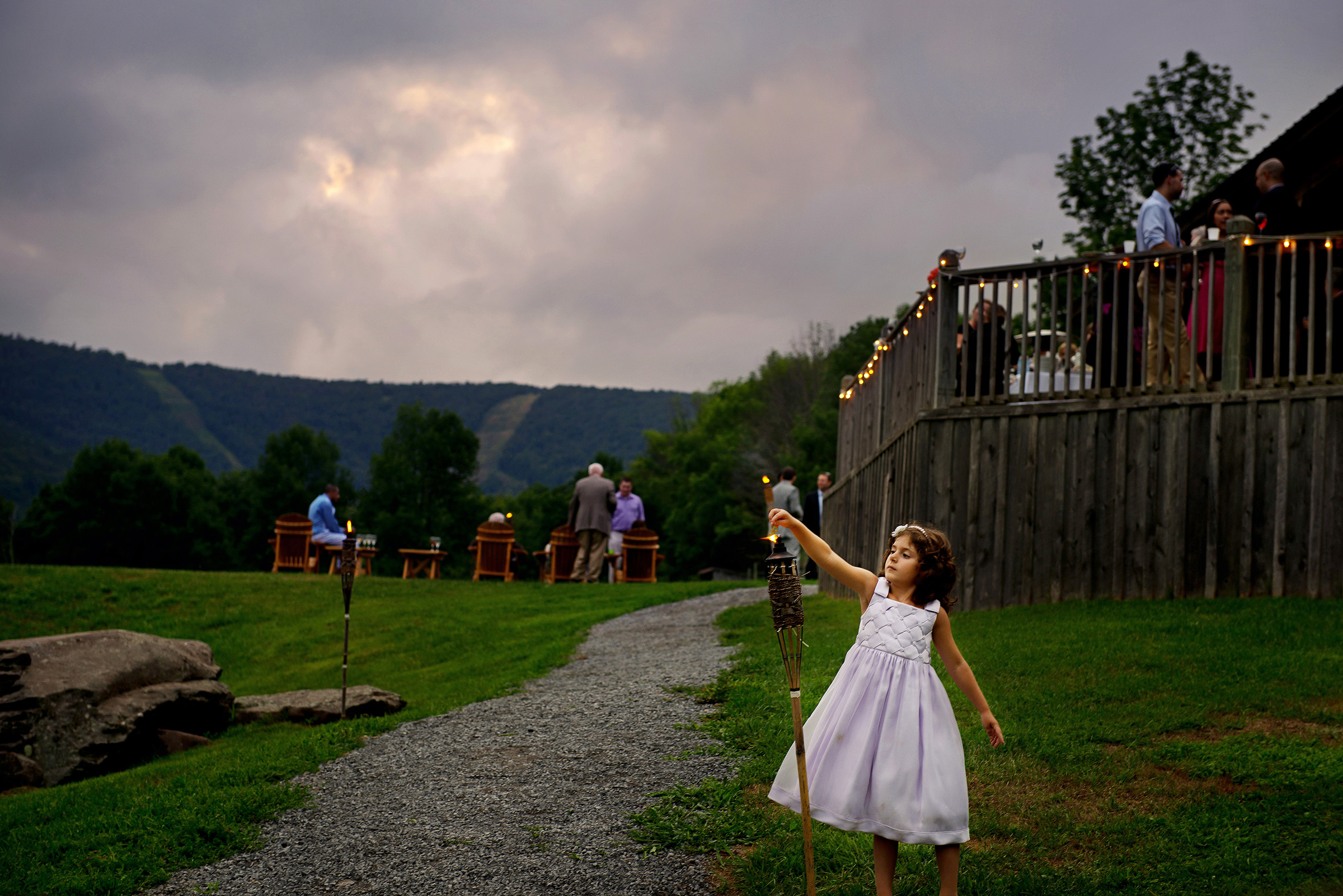 Little girl at tiki torch - photo by Gloria Ruth Photography