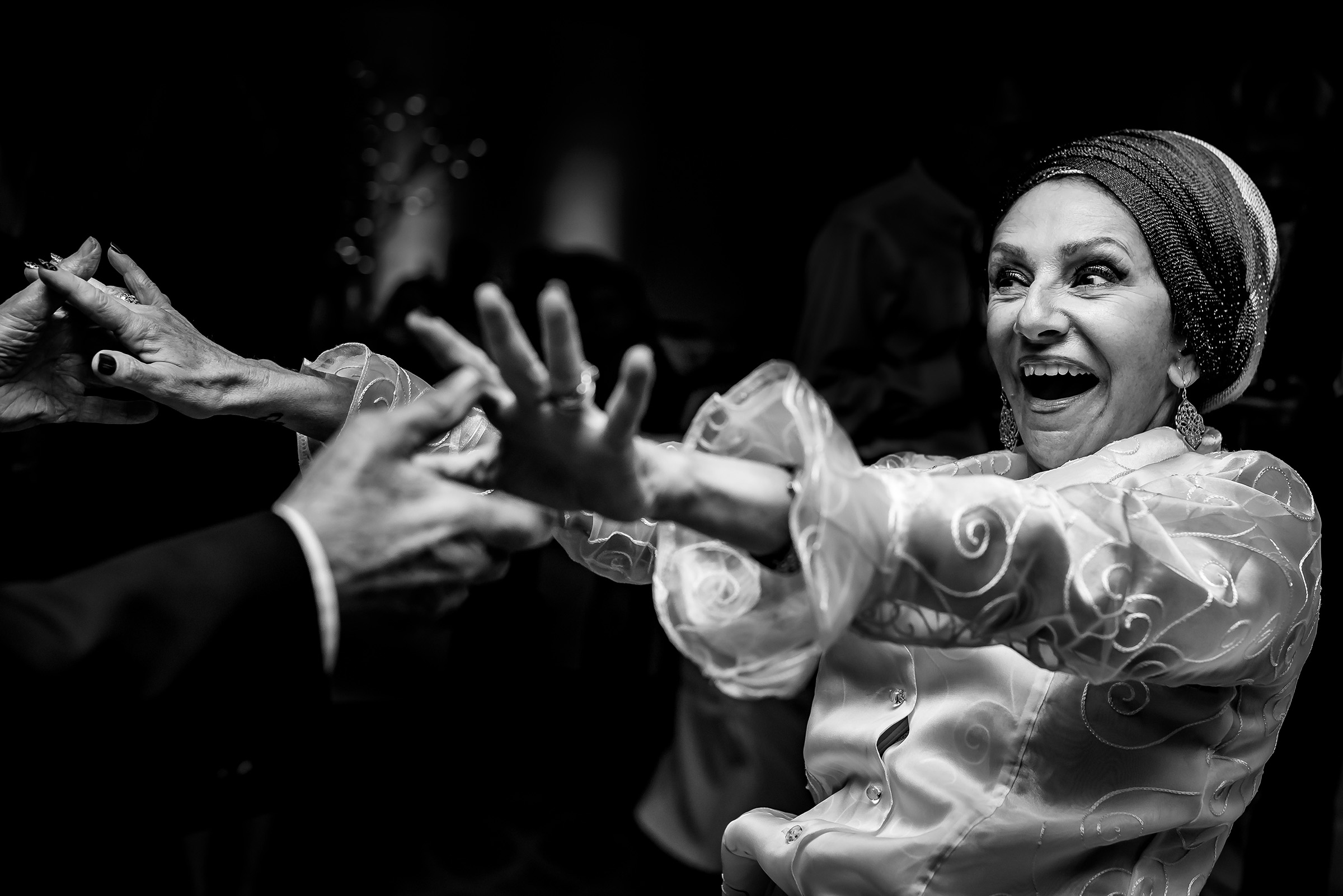 Moment preceding embrace - photo by Gloria Ruth Photography