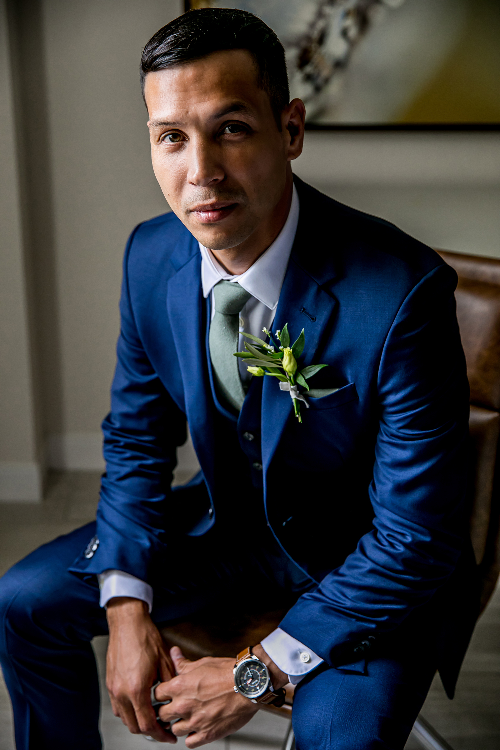 Seated groom portrait - photo by Gloria Ruth Photography